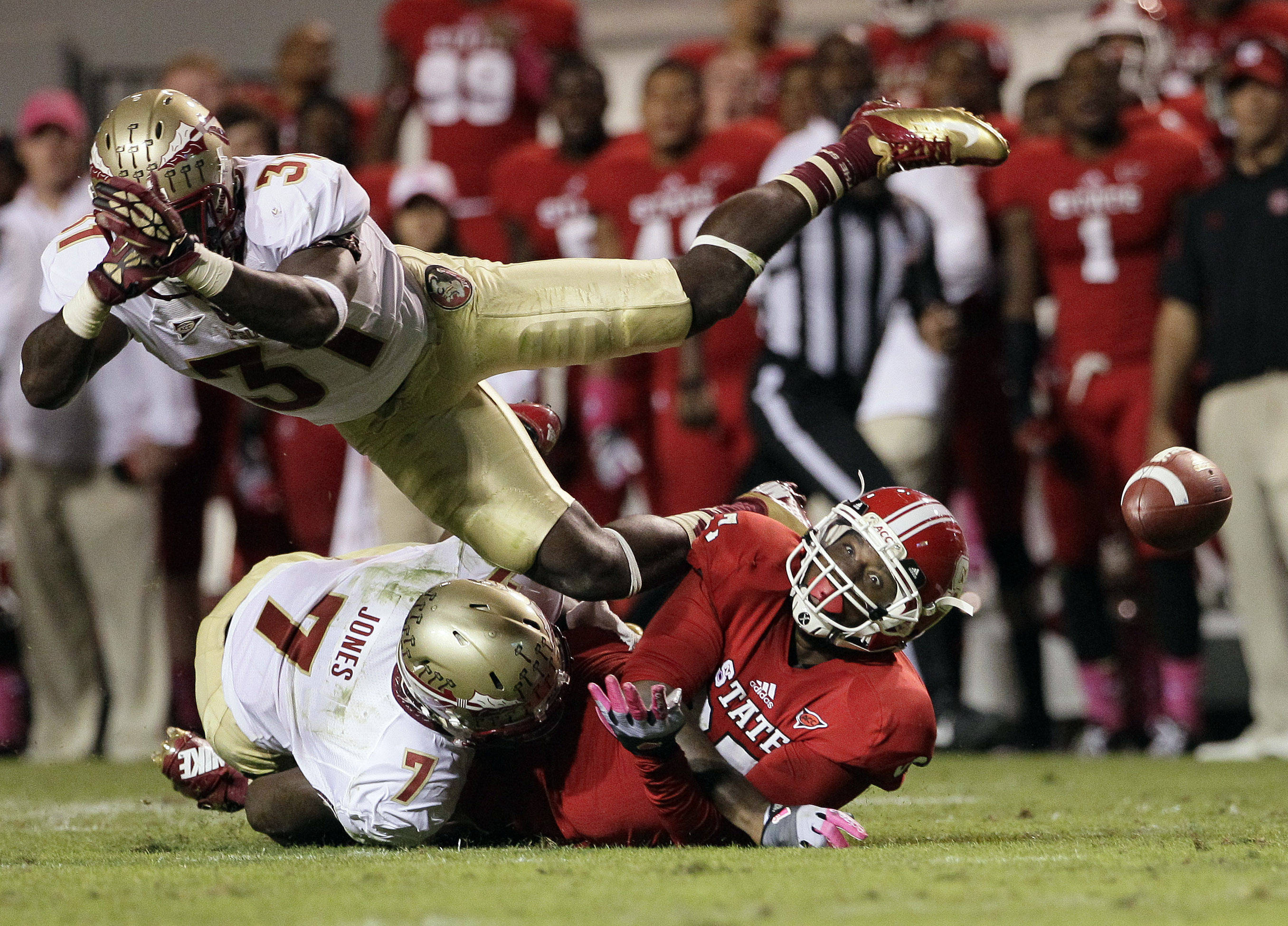 Florida State's Christian Jones (7) and Terrence Brooks break up a pass intended for North Carolina State's Mario Carter during the second half. (AP Photo/Gerry Broome)