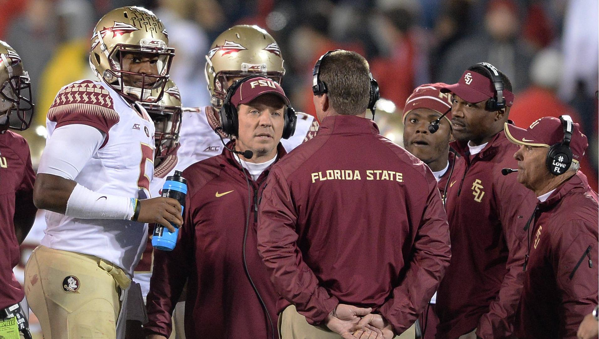 Jimbo Fisher huddles with the offense