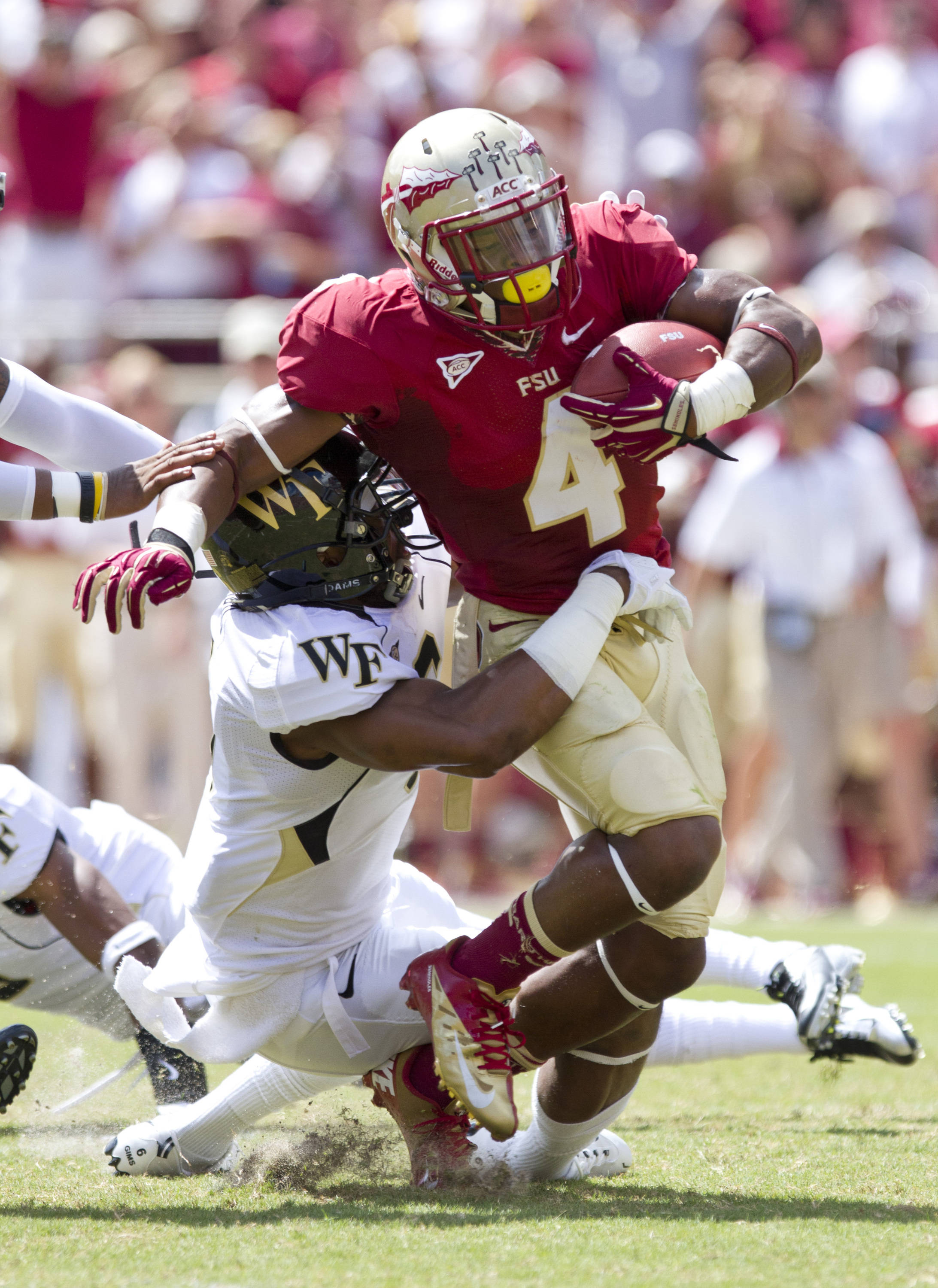 Chris Thompson (4) attempts to break a tackle.