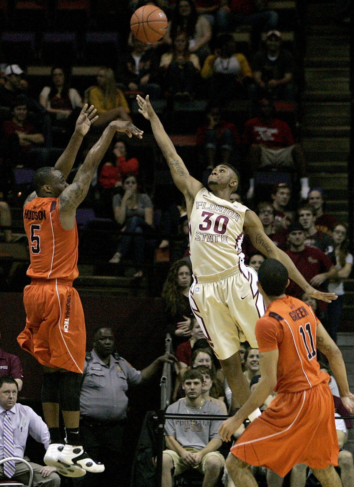 Virginia Tech's Dorenzo Hudson (5) shoots against Florida State's Ian Miller during the first half. (AP Photo/Steve Cannon)