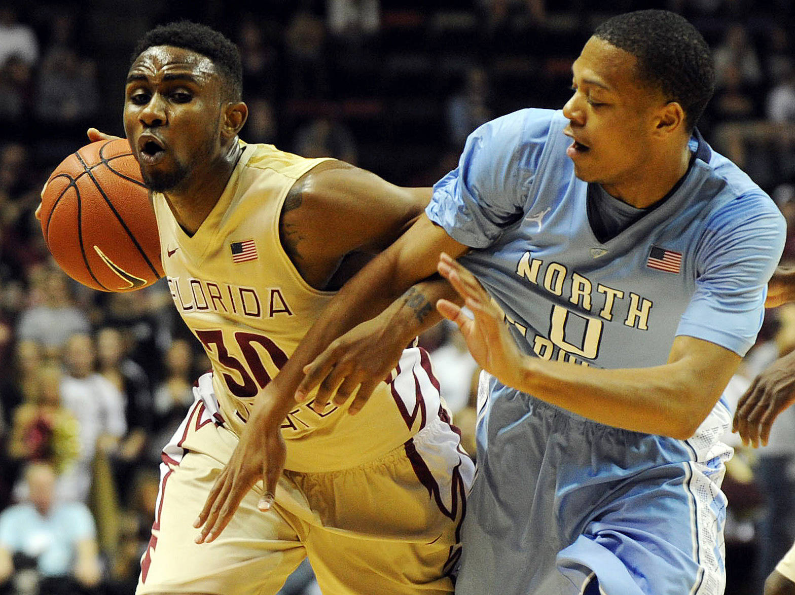 Florida State Seminoles guard Ian Miller (30) is fouled by Nate Britt (0). (Melina Vastola-USA TODAY Sports)