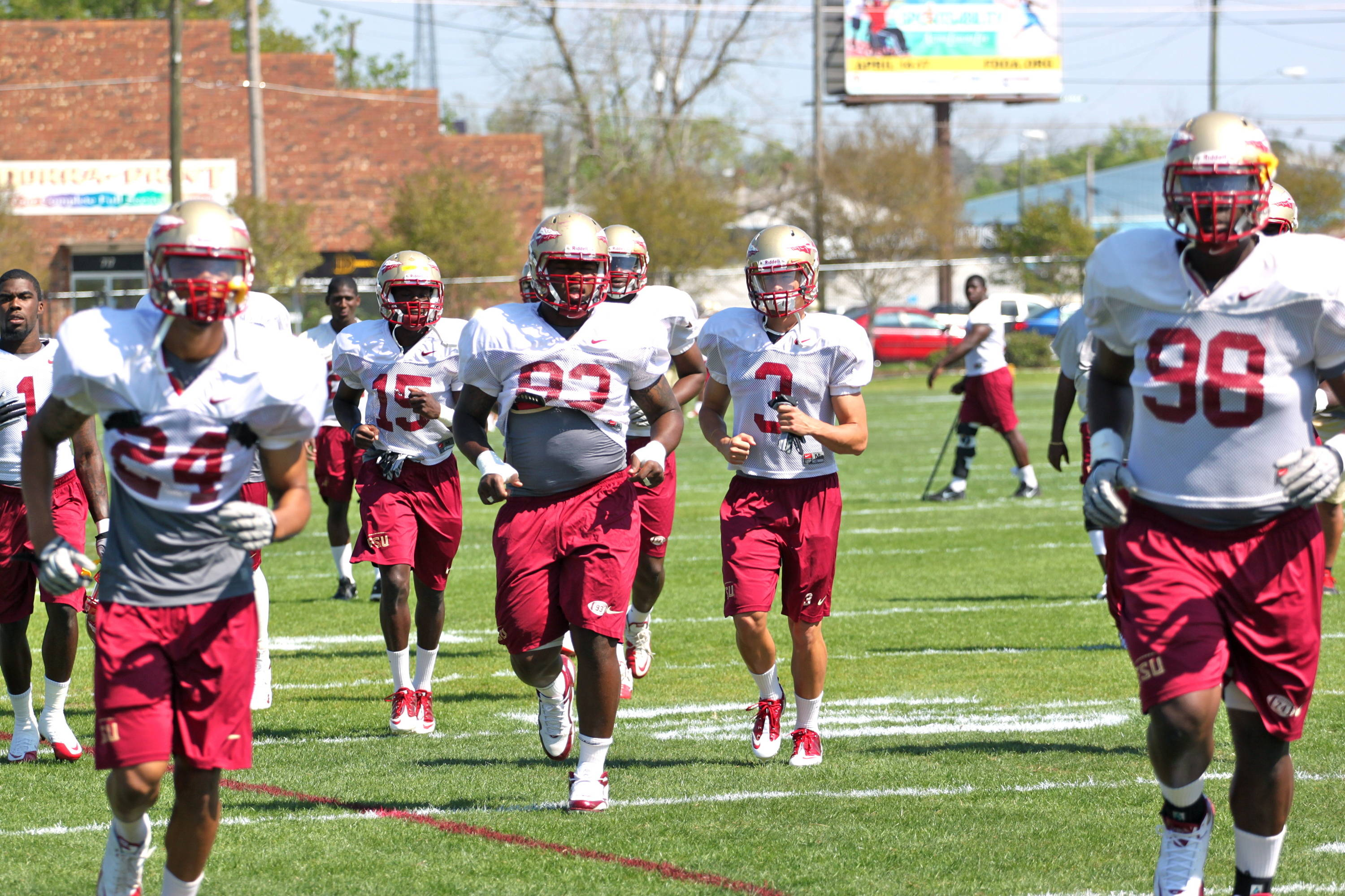 Everett Dawkins (93), Justin Bright (3) run in practice
