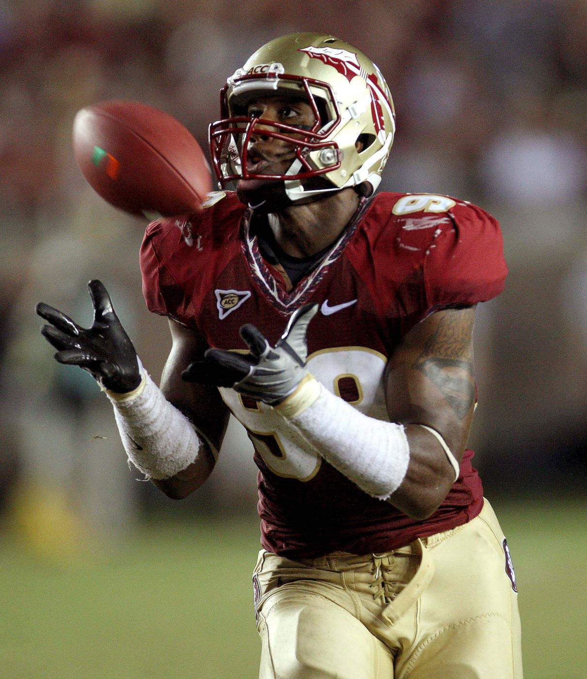 Florida State defensive end Markus White makes a fourth-quarter interception, returning it for a touchdown during an NCAA college football game against Miami, Monday, Sept. 7, 2009, in Tallahassee, Fla. Florida State won 38-34. (AP Photo/Phil Coale)