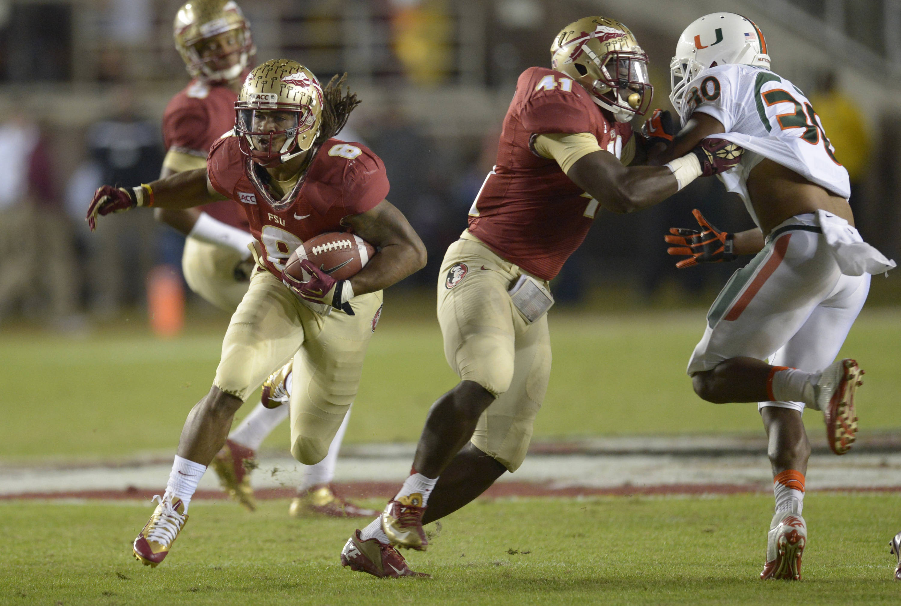 Florida State Seminoles running back Devonta Freeman (8) carries against the Miami Hurricanes during the first quarter at Doak Campbell Stadium. Mandatory Credit: John David Mercer-USA TODAY Sports
