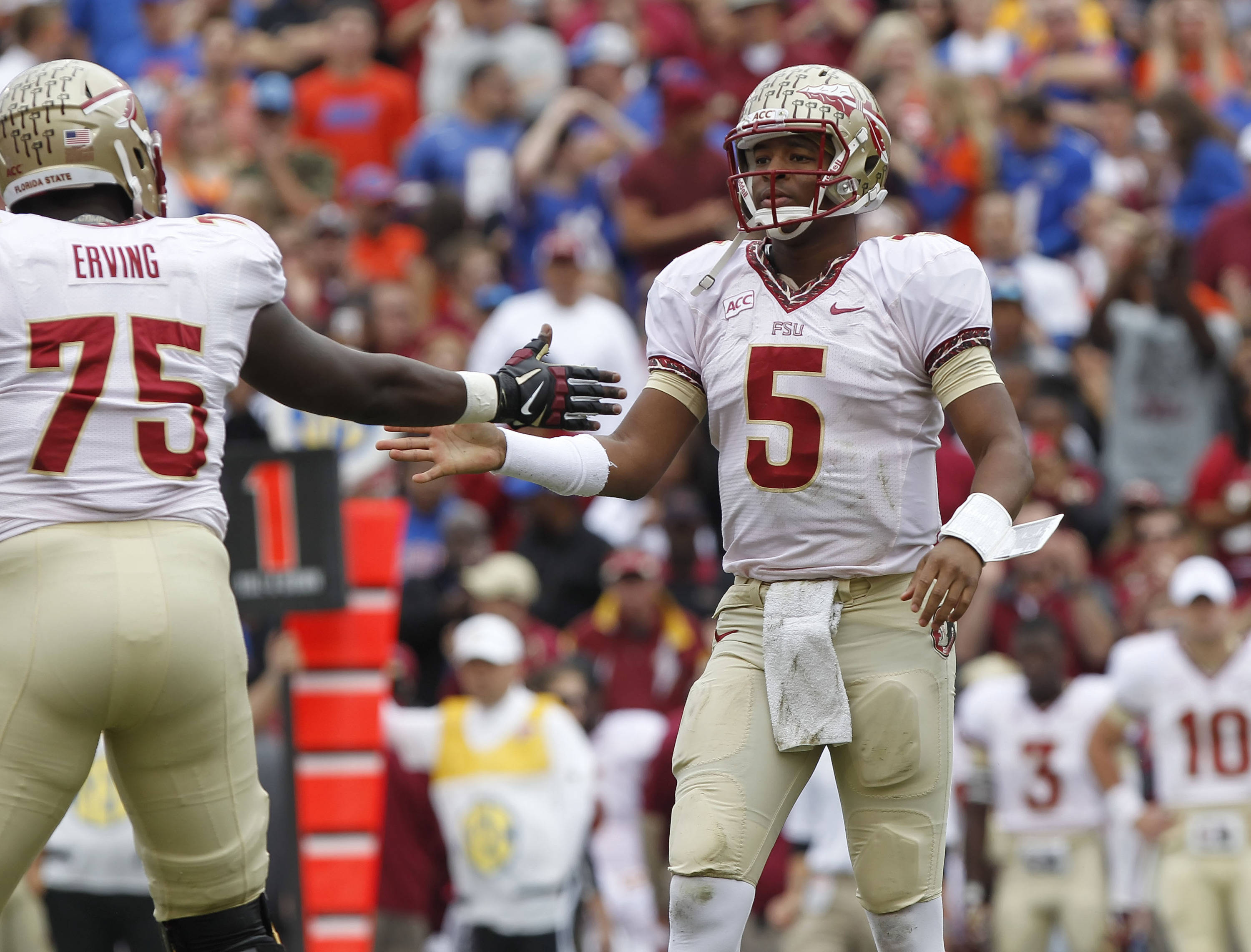 Jameis Winston (5) high fives offensive linesman Cameron Erving (75). Mandatory Credit: Kim Klement-USA TODAY Sports