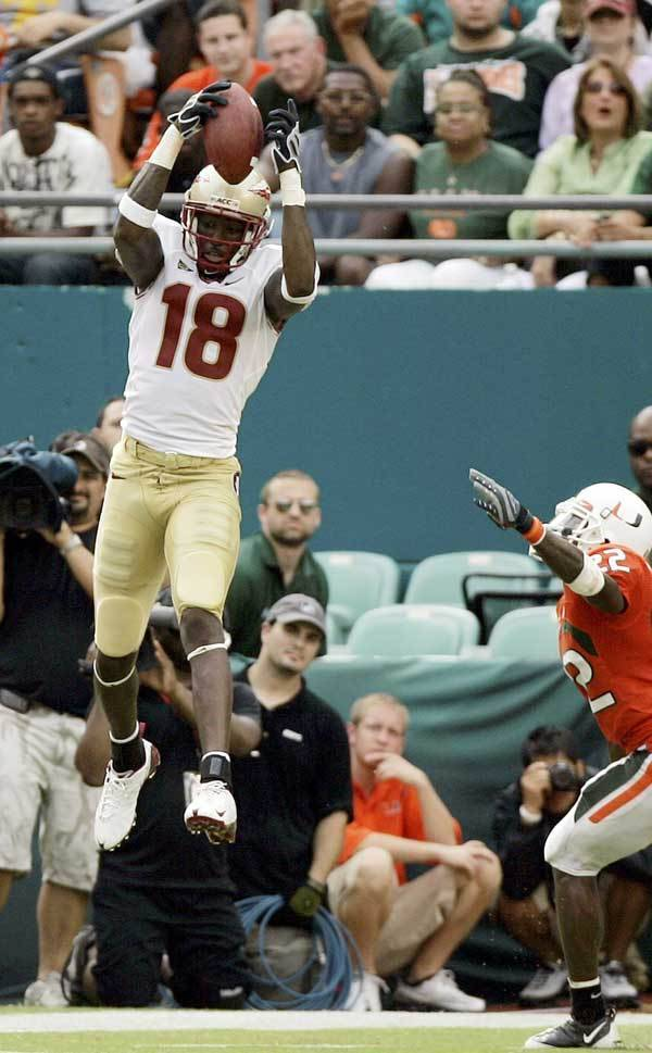 Florida State's Greg Carr (18) catches a pass for a touchdown against Miami in the second quarter