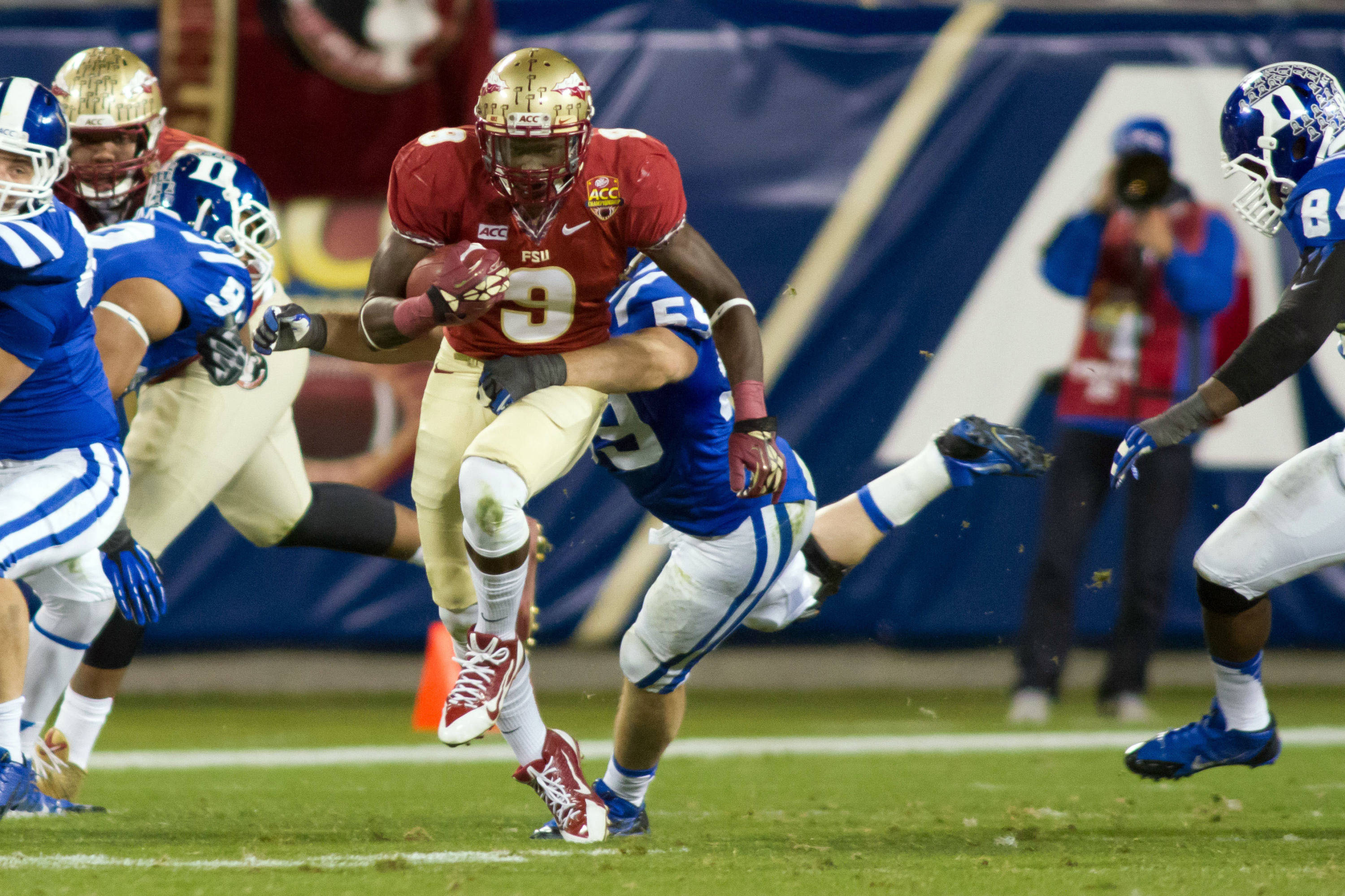 Dec 7, 2013; Charlotte, NC, USA; Florida State Seminoles running back Karlos Williams (9) runs the ball during the second quarter against the Duke Blue Devils at Bank of America Stadium. Mandatory Credit: Jeremy Brevard-USA TODAY Sports