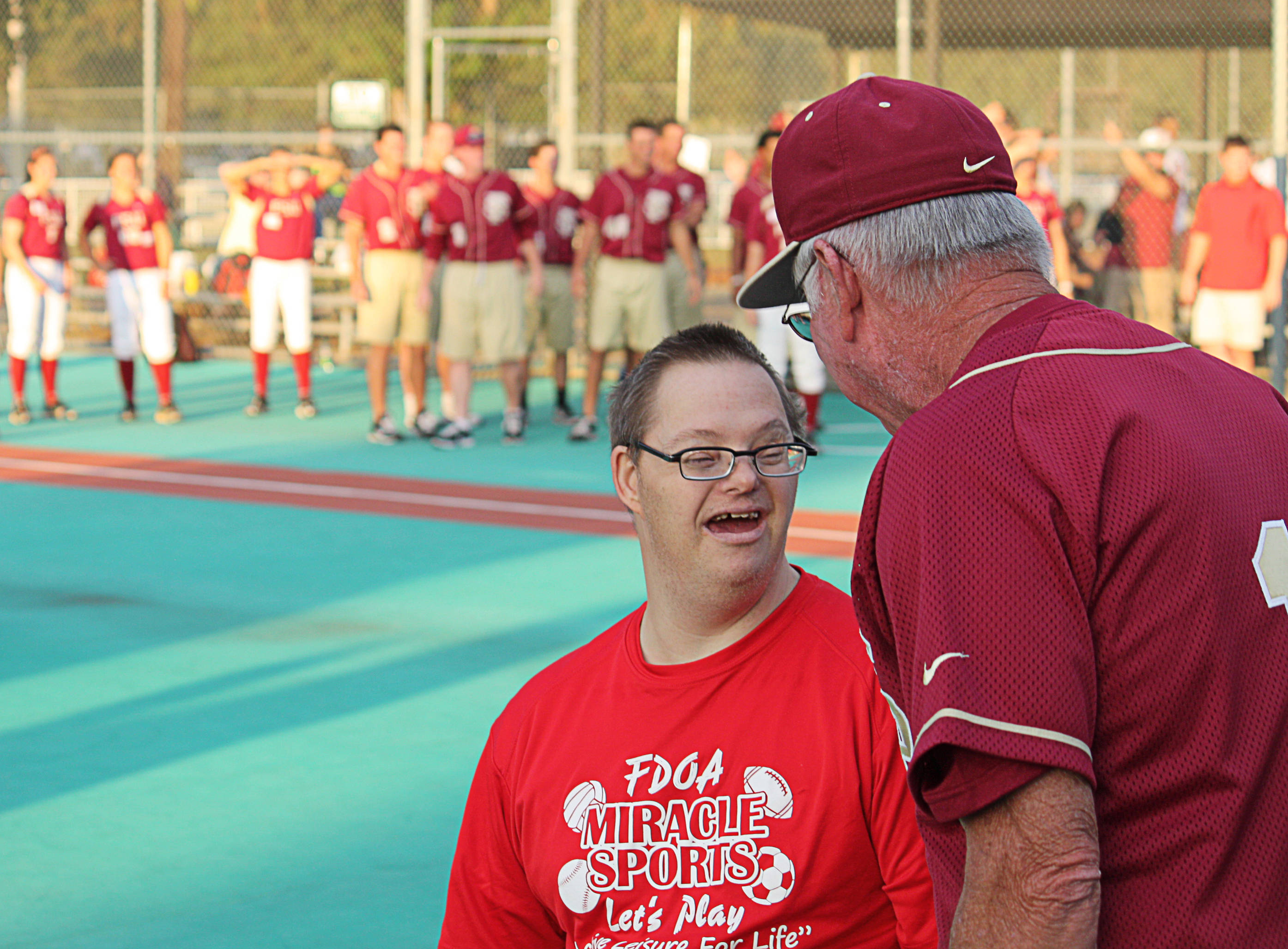 Mike Martin (11) chats with Miracle League's Mike Martin