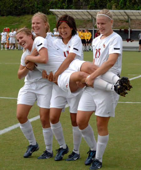 Kirsten van de Ven and her international family during Senior Day ceremonies at the Seminole Soccer Complex.