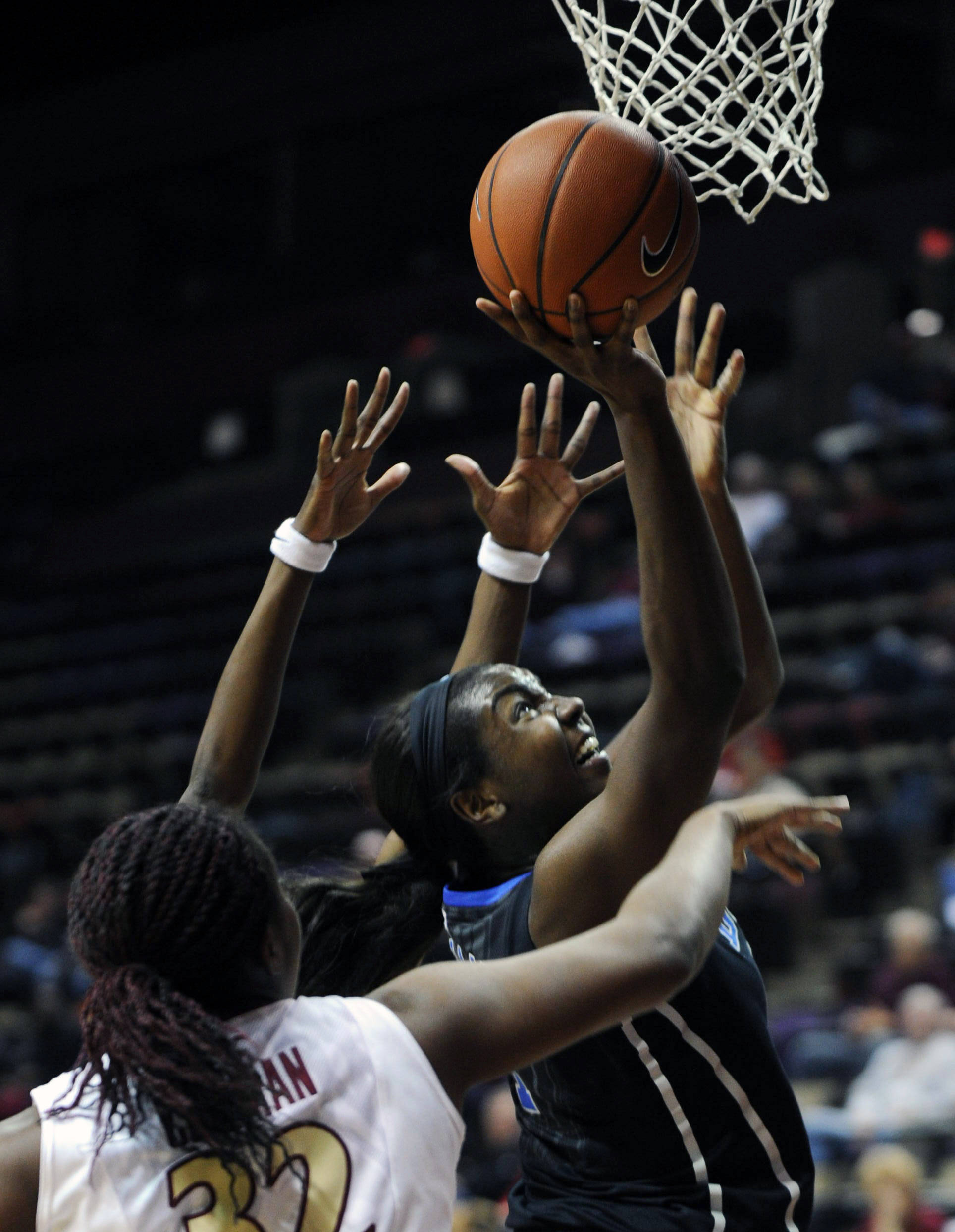 Jan 23, 2014; Tallahassee, FL, USA; Duke Blue Devils center Elizabeth Williams (1) shoots the ball against Florida State Seminoles forward Lauren Coleman (32) during the first half of the game at the Donald L. Tucker Center (Tallahassee). Mandatory Credit: Melina Vastola-USA TODAY Sports