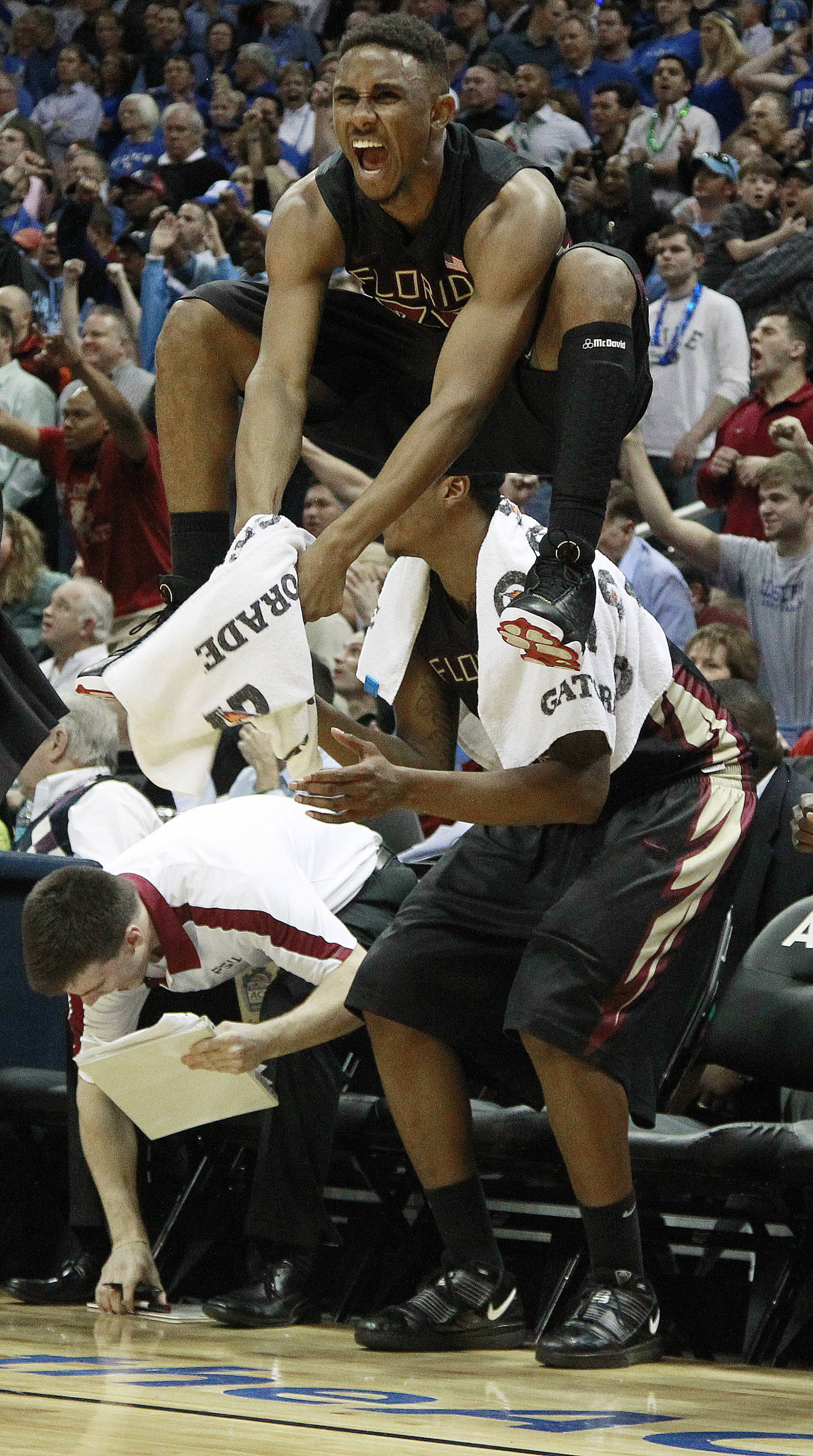 Florida State guard Ian Miller (30) reacts on the sideline after teammate Luke Loucks scored a basket against Duke during the second half of an NCAA college basketball game in the semifinals of the Atlantic Coast Conference tournament, Saturday, March 10, 2012, in Atlanta. Florida State won 62-59. (AP Photo/John Bazemore)