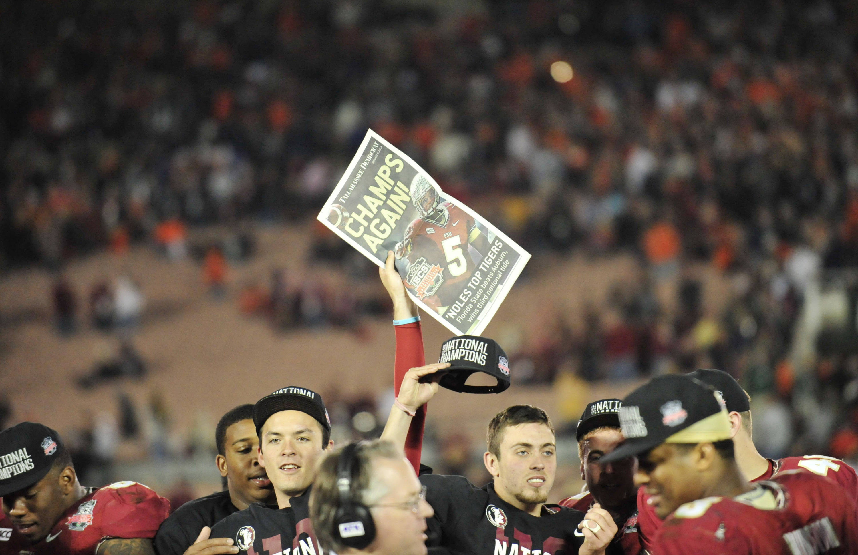 Jan 6, 2014; Pasadena, CA, USA; Florida State Seminoles players celebrate after the 2014 BCS National Championship game against the Auburn Tigers at the Rose Bowl. The Seminoles defeated the Tigers 34-31. Mandatory Credit: Gary A. Vasquez-USA TODAY Sports