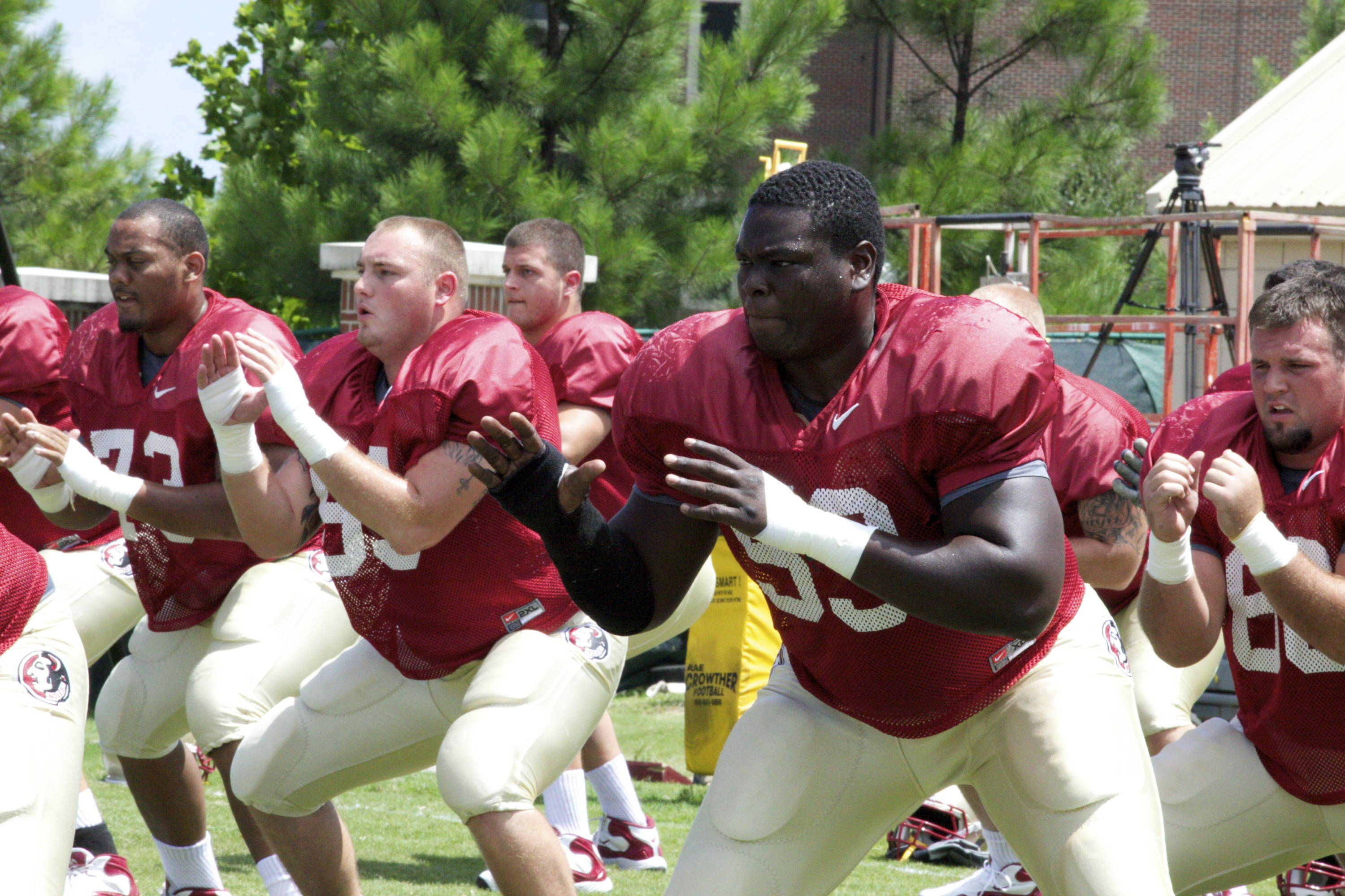 Offensive line in a drill before practice