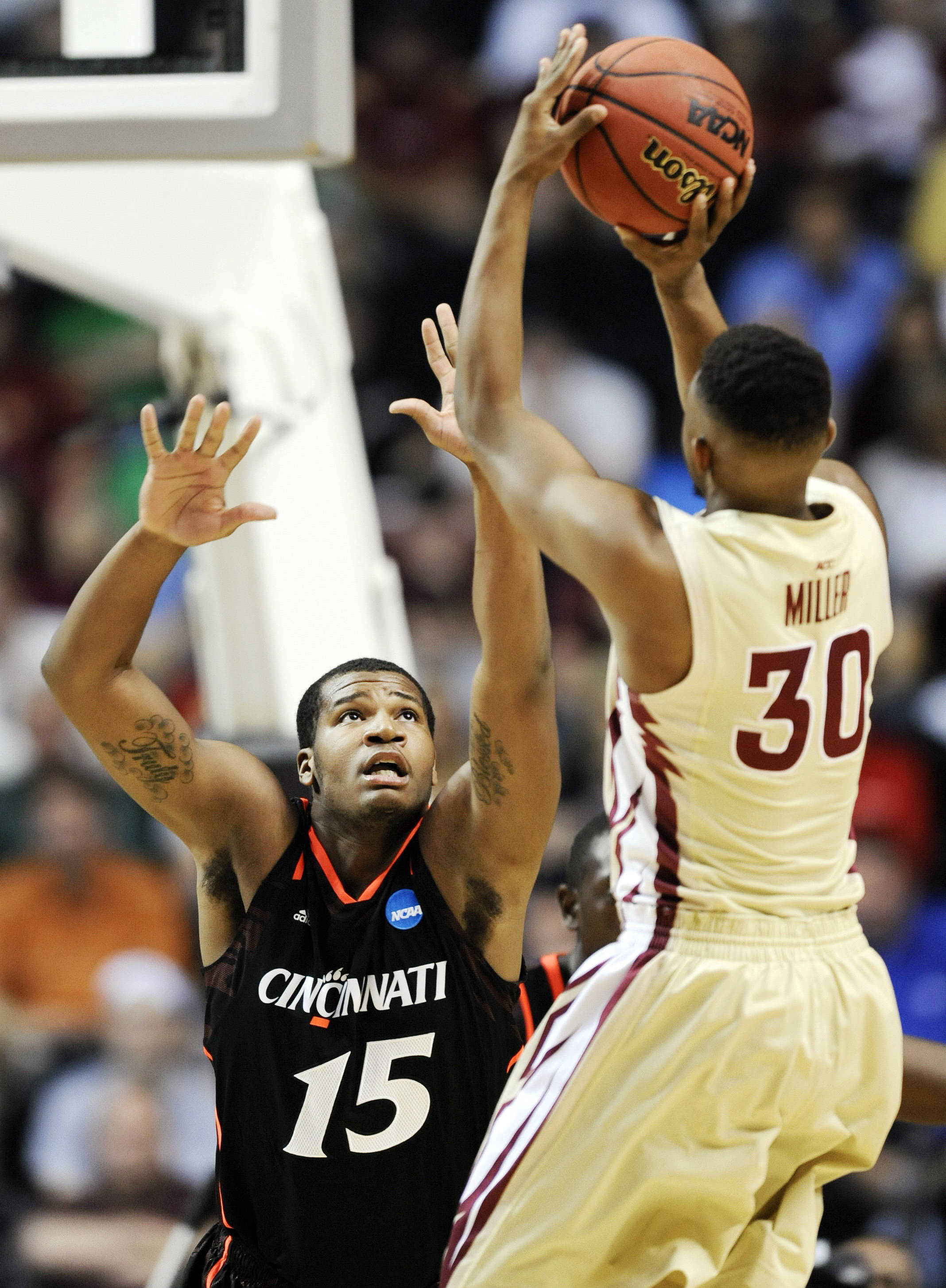 Cincinnati forward Jermaine Sanders (15) defends as Florida State guard Ian Miller (30) shoots. (AP Photo/Donn Jones)