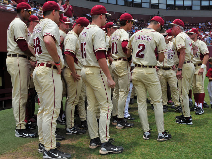 The Seminoles huddle around head coach Mike Martin before the start of Sunday's game.