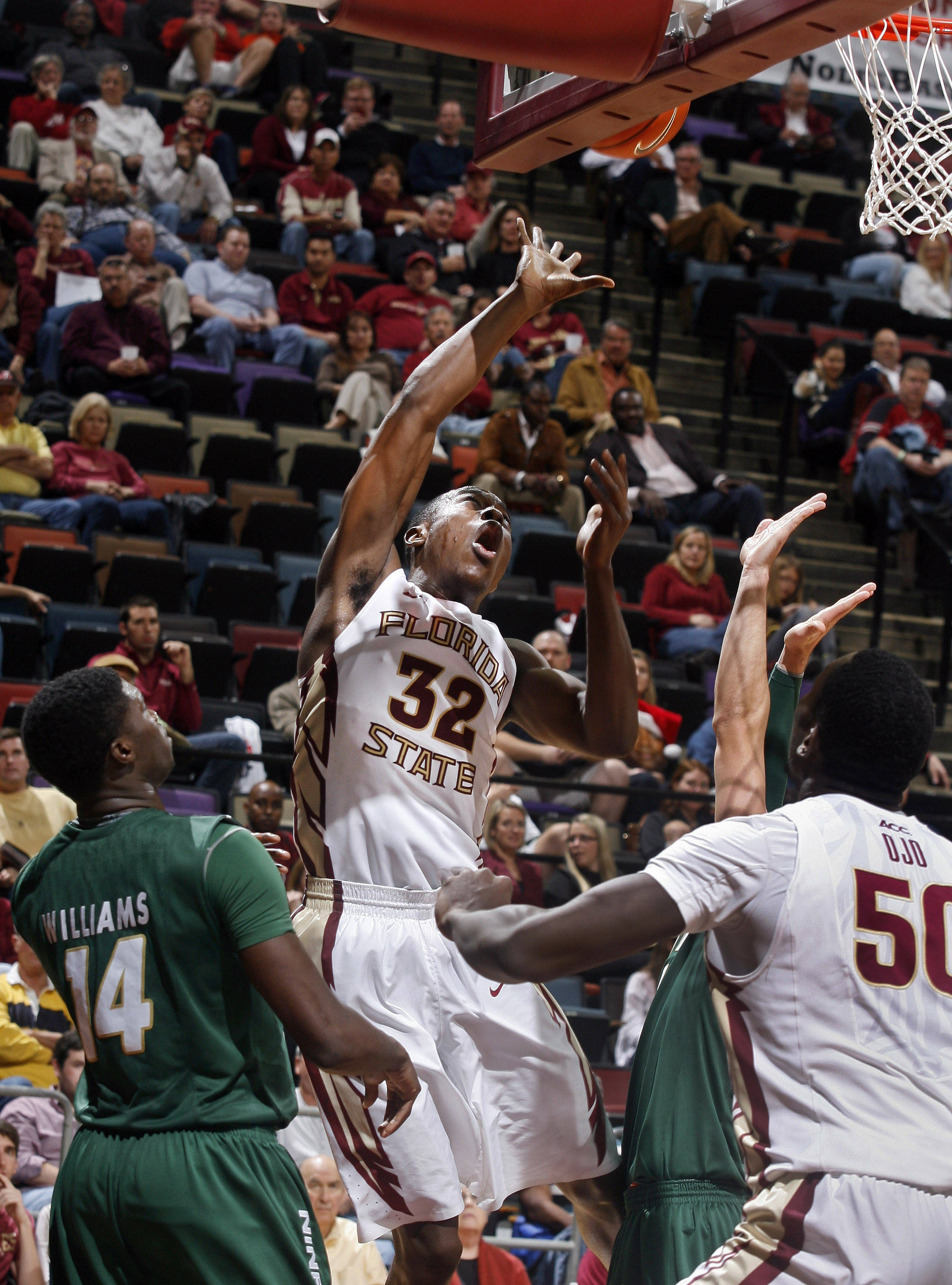 Dec 17, 2013; Tallahassee, FL, USA; Florida State Seminoles guard Montay Brandon (32) makes a basket as he is fouled by Charlotte 49ers guard Terrence Williams (14) in the second half of their game at the Donald L. Tucker Center. The Florida State Seminoles beat the Charlotte 49ers 106-62. Mandatory Credit: Phil Sears-USA TODAY Sports