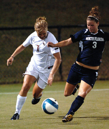 Katrin Schmidt battles for possession against the Osprey defender.