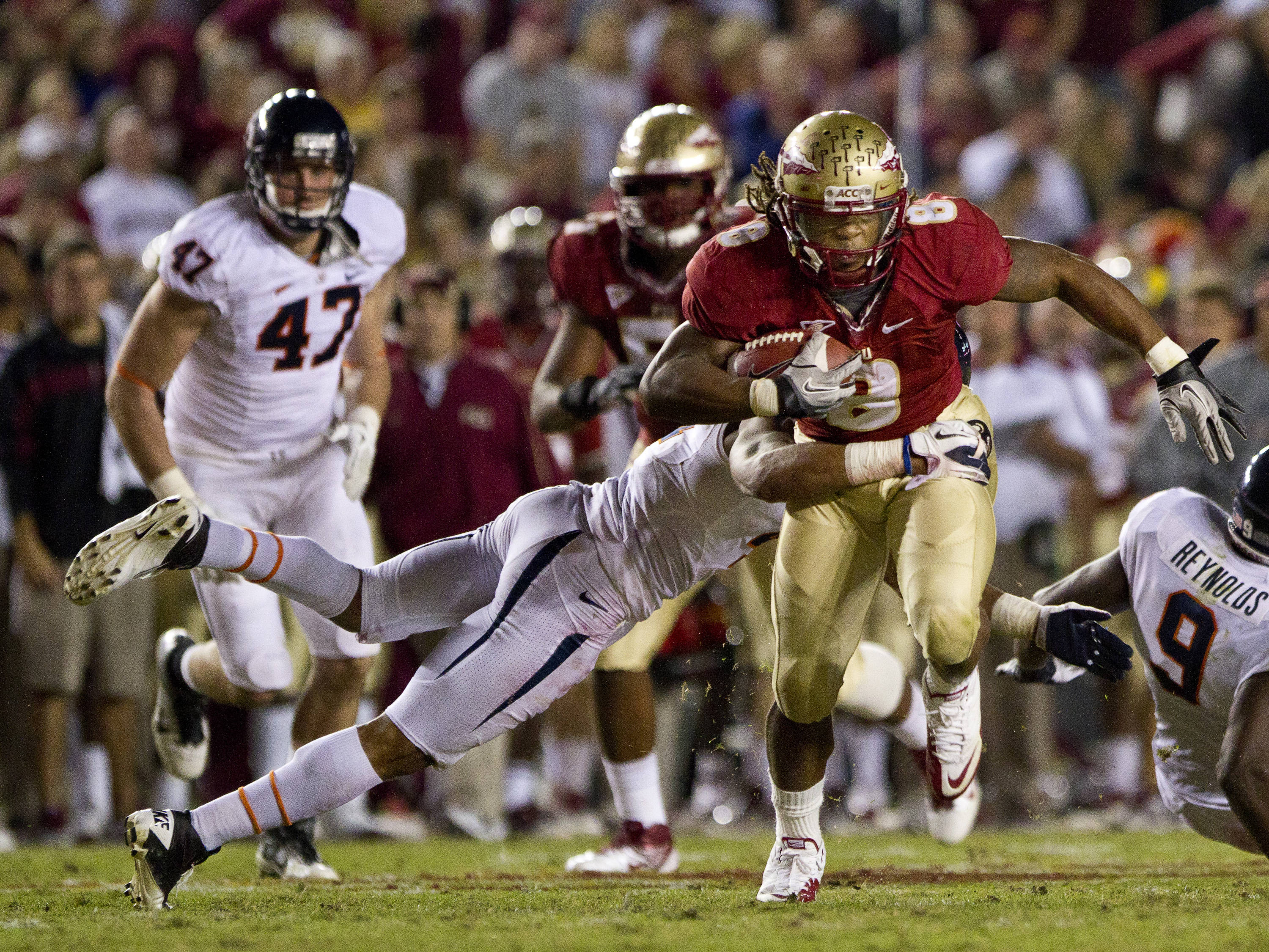 Timmy Jernigan (8) takes a hit while running the ball during the game against Virginia on November 19, 2011.