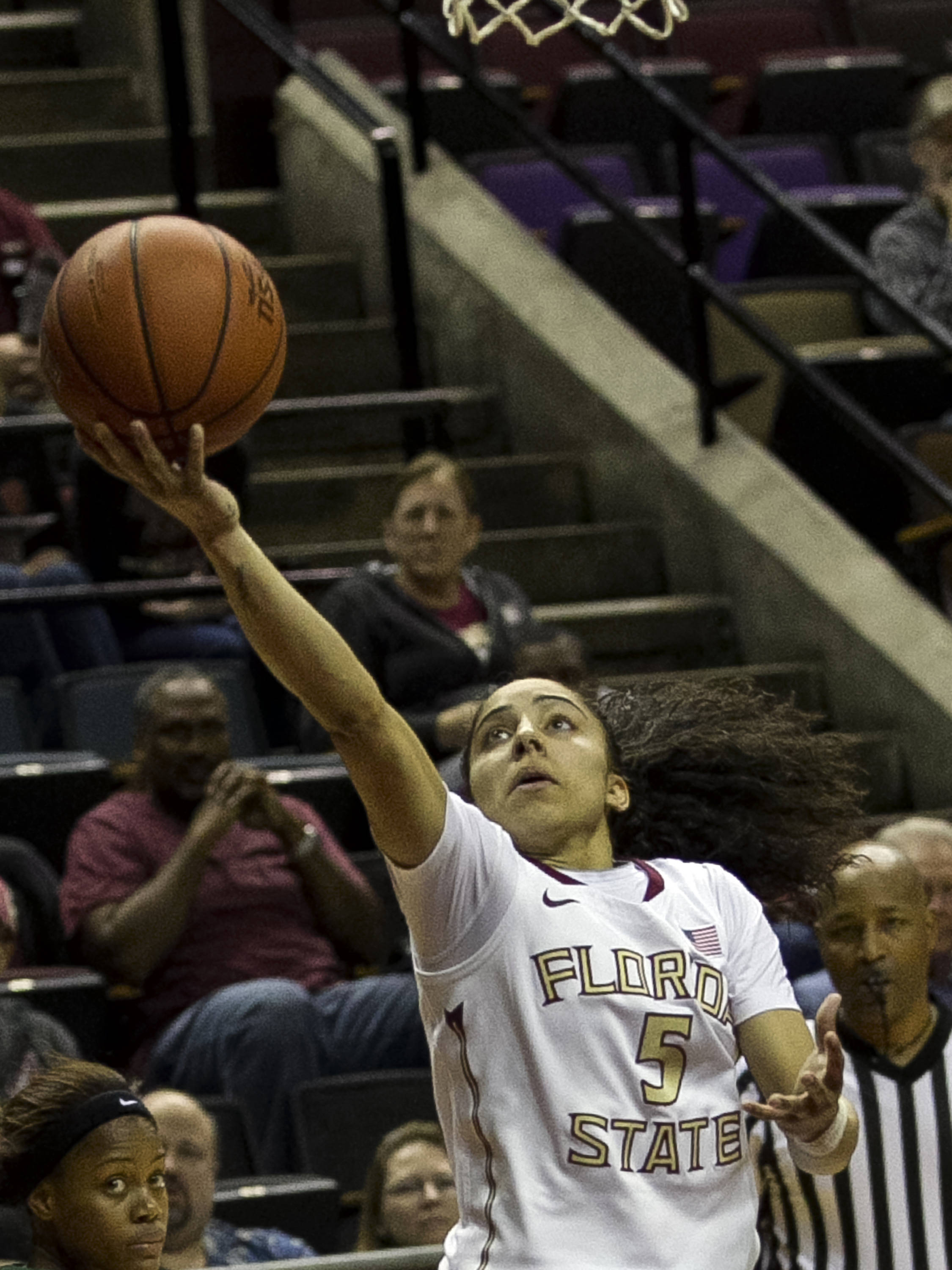Cheetah Delgado (5) stretches out for her lay-up, FSU vs Miami, 2-16-14, (Photo's by Steve Musco)