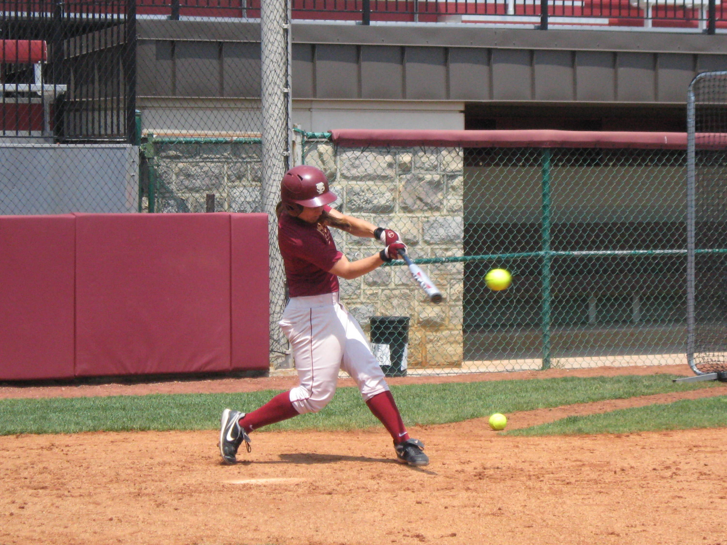 Jen Lapicki connects on a pitch during practice on Thursday.