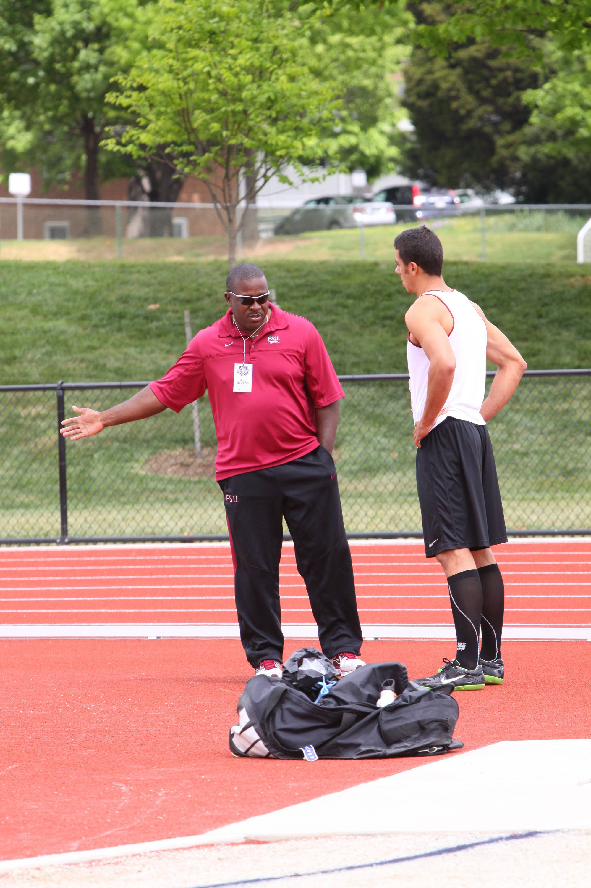FSU Associate Head Coach and Throws mentor Harlis Meaders shared some pointers with Barroilhet between attempts.