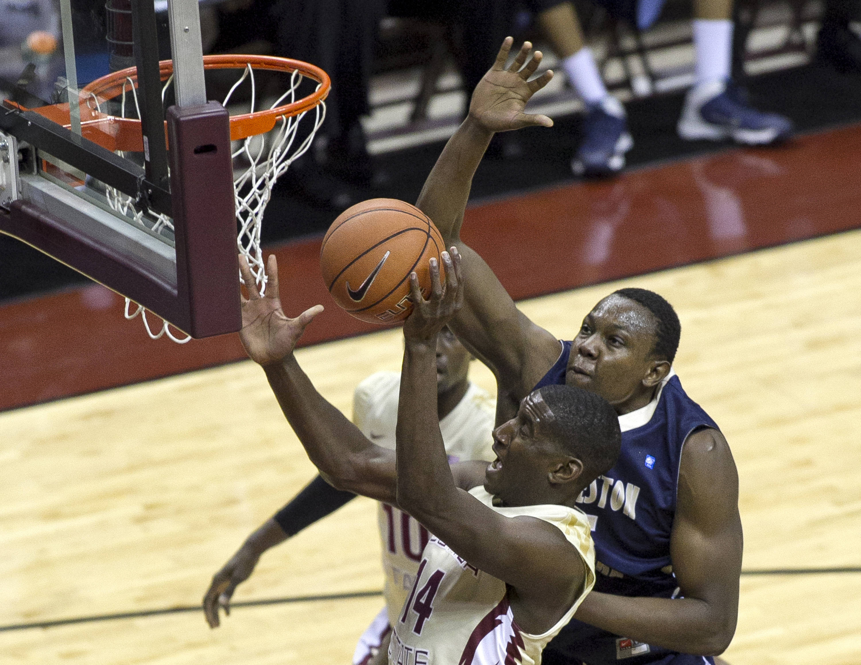 Robert Gilchrist (14) fighting for a layup, FSU vs Charleston Southern, 12-30-13,  (Photo by Steve Musco)