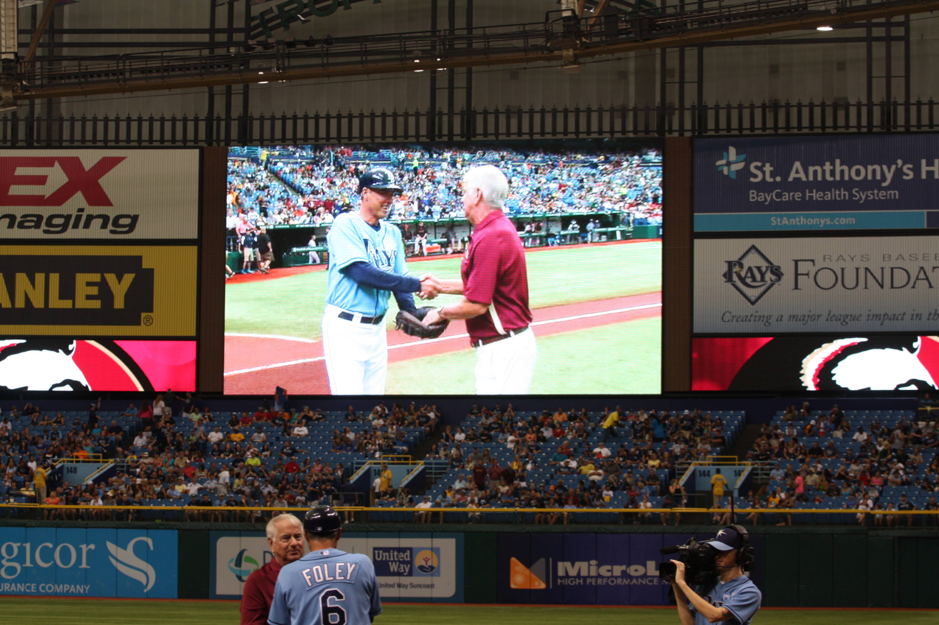 Head coach Mike Martin shakes hands with Rays third base coach Tom Foley who caught the ceremonial first pitch.