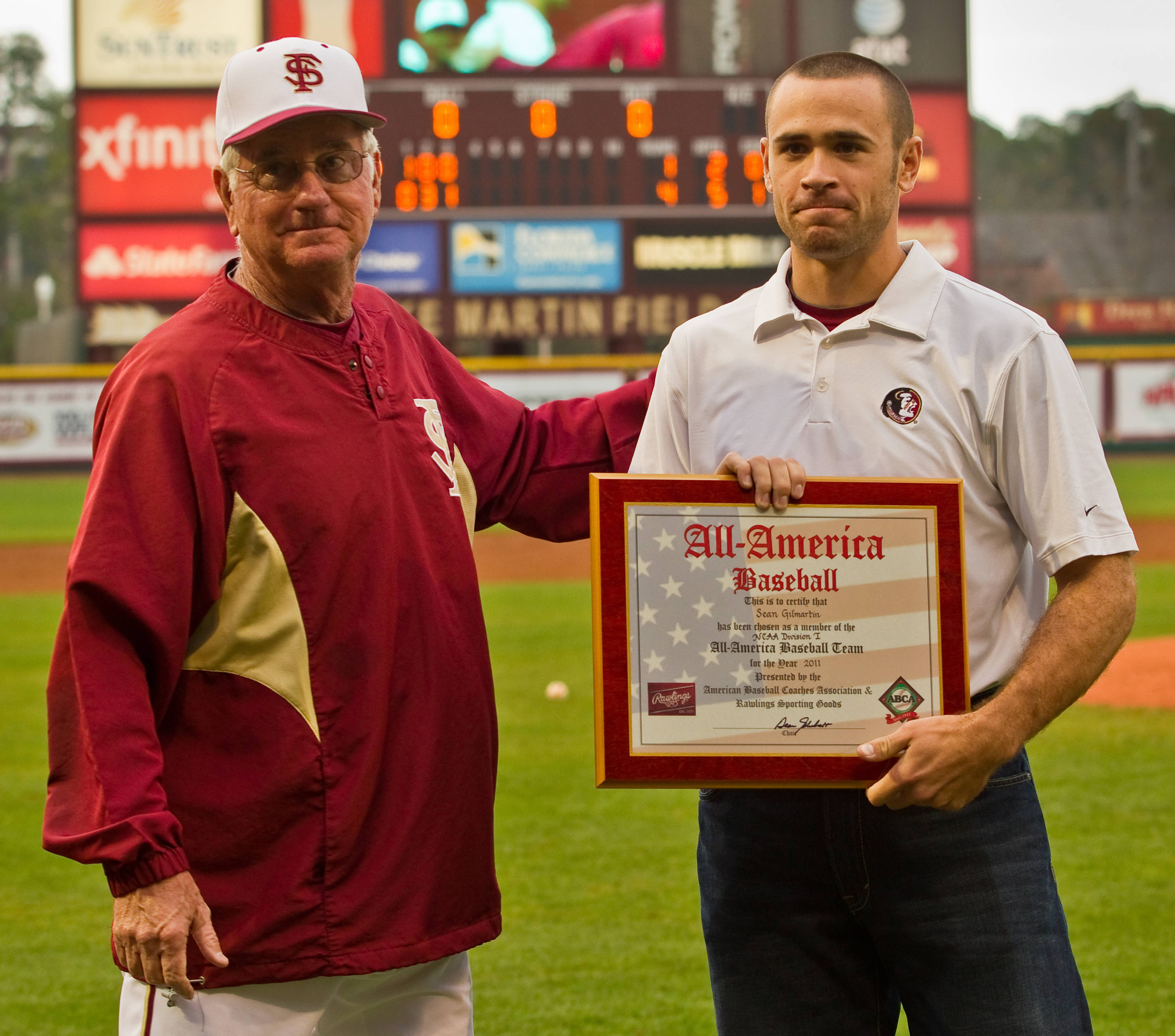 Head coach Mike Martin presents Sean Gilmartin with his 2011 All-America award in the fourth inning.