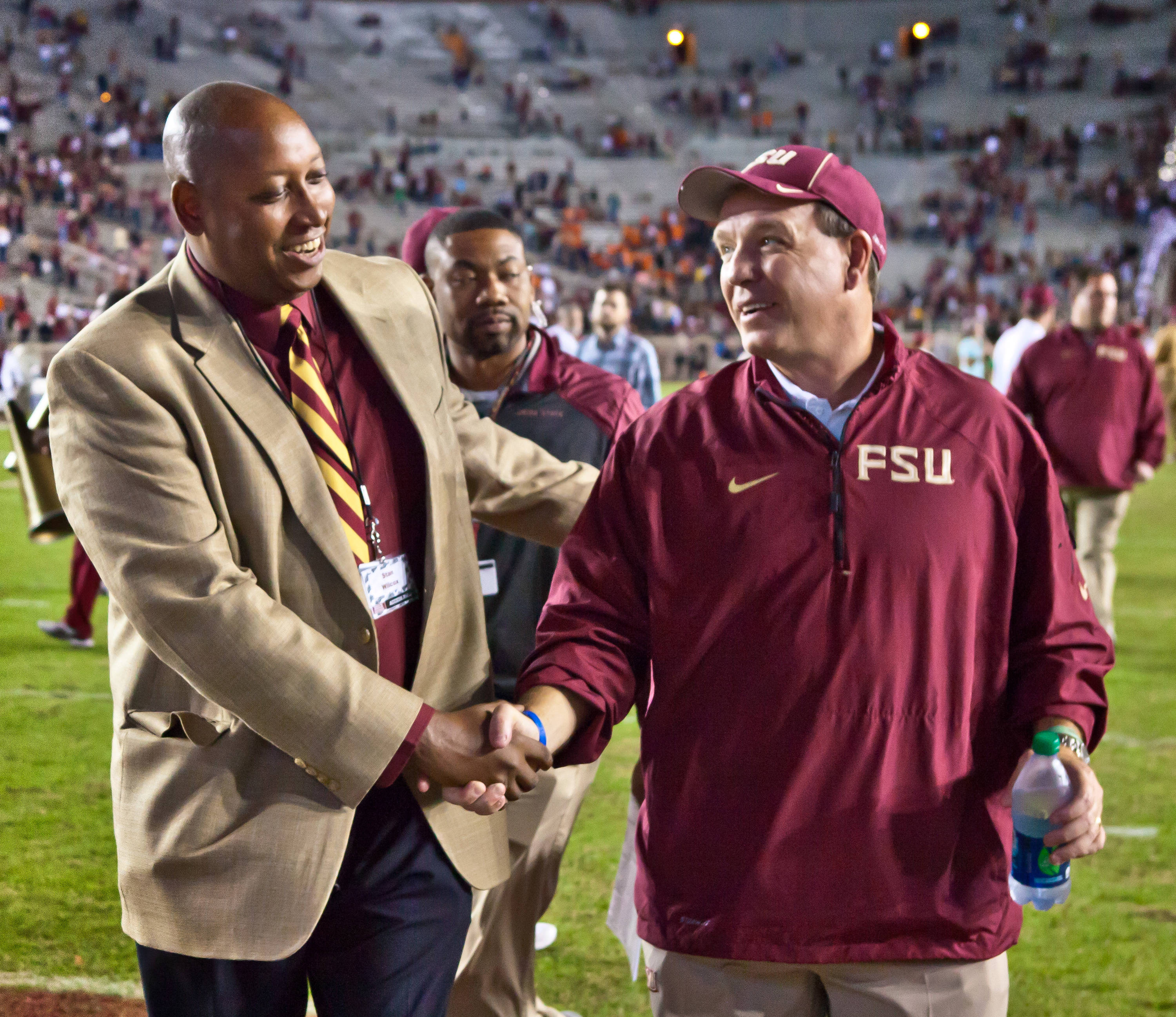 AD Stan Wilcox congratulates Jimbo Fisher on the 59-3 win over Syracuse.