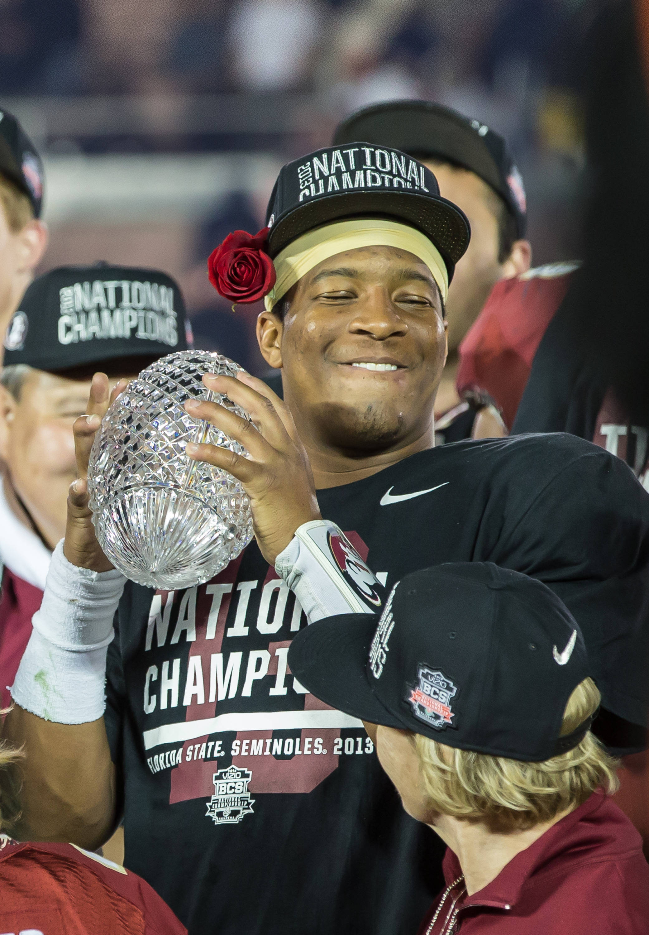 Jameis Winston (5) cradles the Championship Trophy.