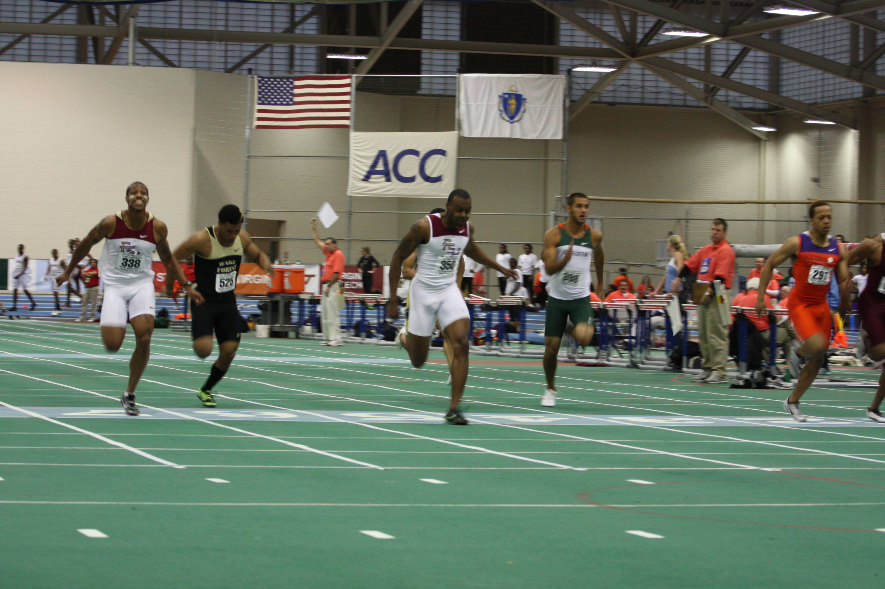 Maurice Mitchell (near left) and Horatio Williams (center) qualified for the finals of the 60-meter dash, despite misjudging the finish line in Friday's preliminary round.