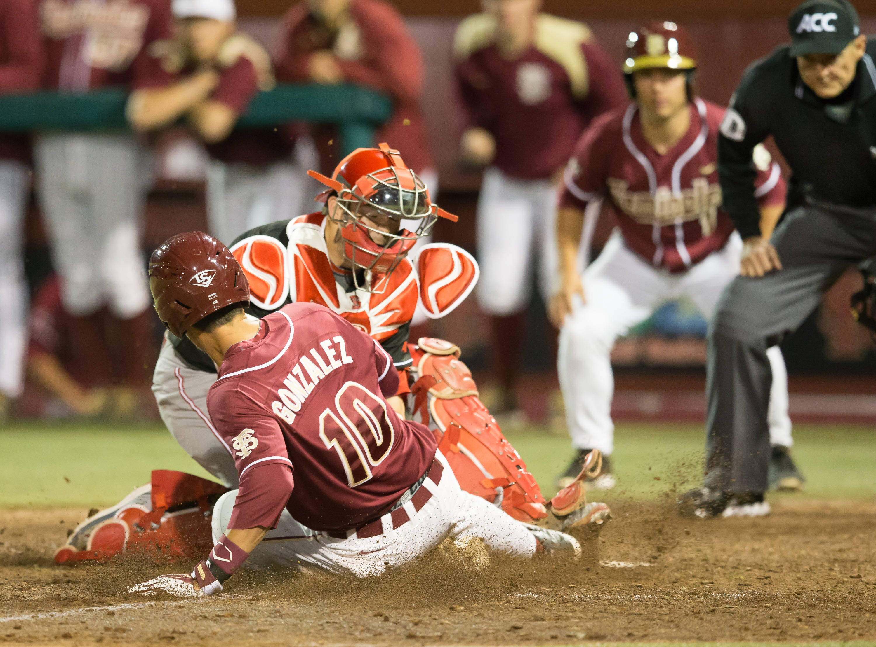 Justin Gonzalez (10) is tagged out trying to score in the 8th inning.