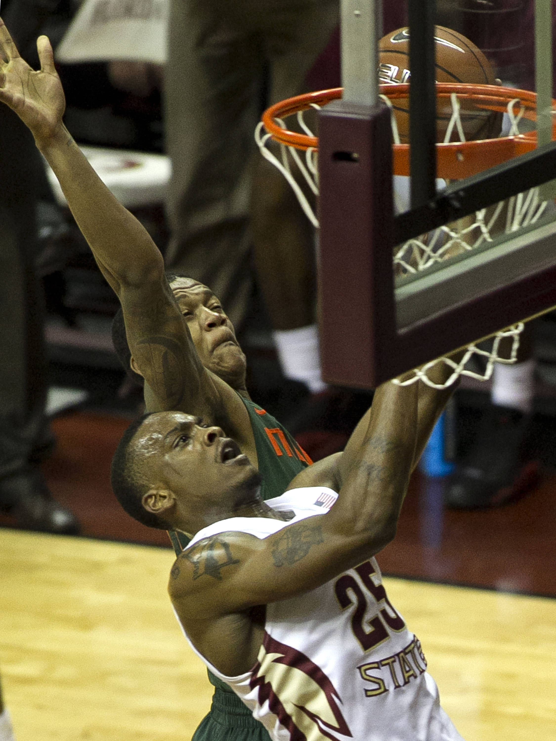 Aaron Thomas (25) with two tough points, FSU vs Miami, 2-10-14, (Photo's by Steve Musco)
