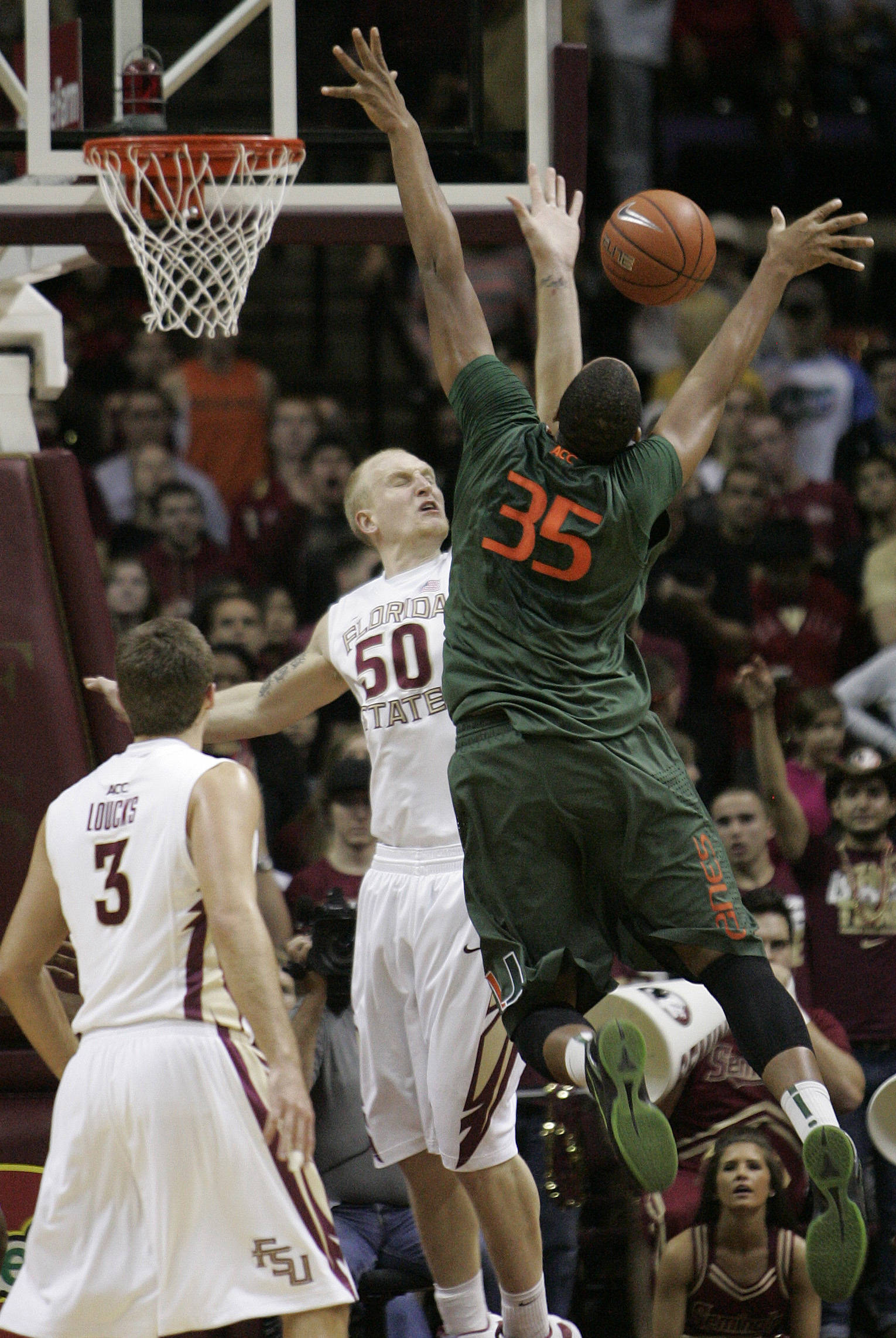 Florida State's Jon Kreft (50) blocks the shot attempt of Miami's Kenny Kadji  during the first half of an NCAA college basketball game on Saturday, Feb. 11, 2012 in Tallahassee, Fla.(AP Photo/Steve Cannon)