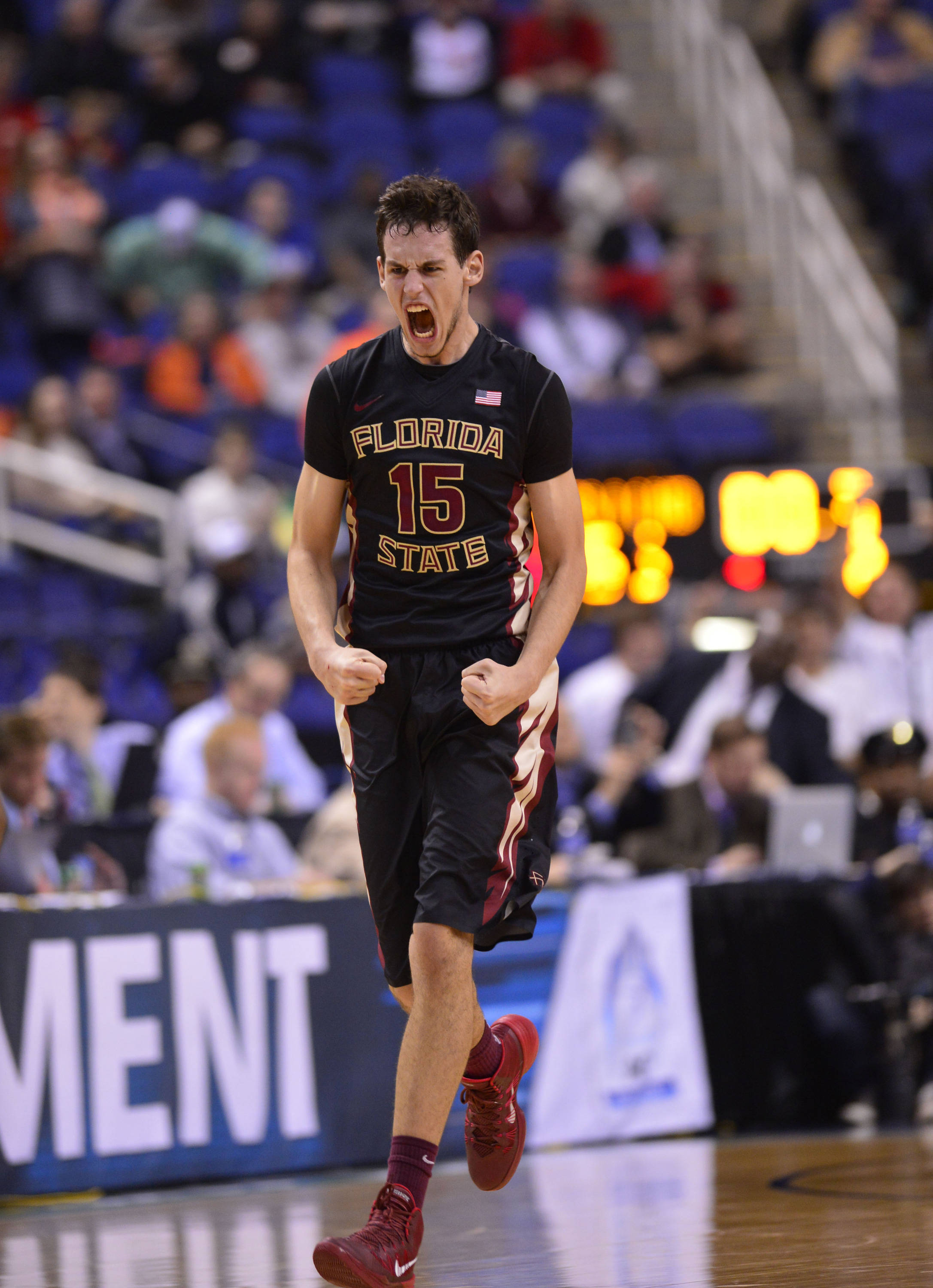 Florida State Seminoles center Boris Bojanovsky (15) reacts after hitting the game winning shot. The Seminoles defeated the Terrapins 67-65 in the second round of the ACC college basketball tournament at Greensboro Coliseum. Mandatory Credit: Bob Donnan-USA TODAY Sports