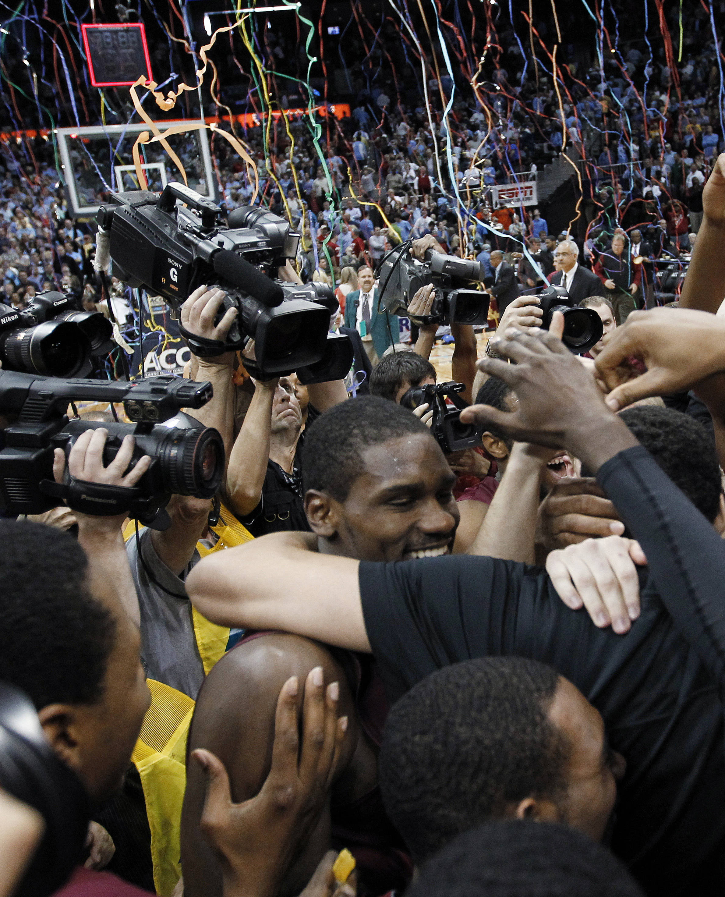 Michael Snaer is swarmed by teammates. (AP Photo/John Bazemore)