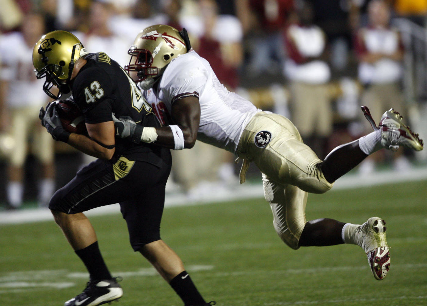 Colorado fullback Samson Jagoras, left, is tackled, after pulling in a screen pass, by Florida State linebacker Geno Hayes in the first quarter. (AP Photo/David Zalubowski)