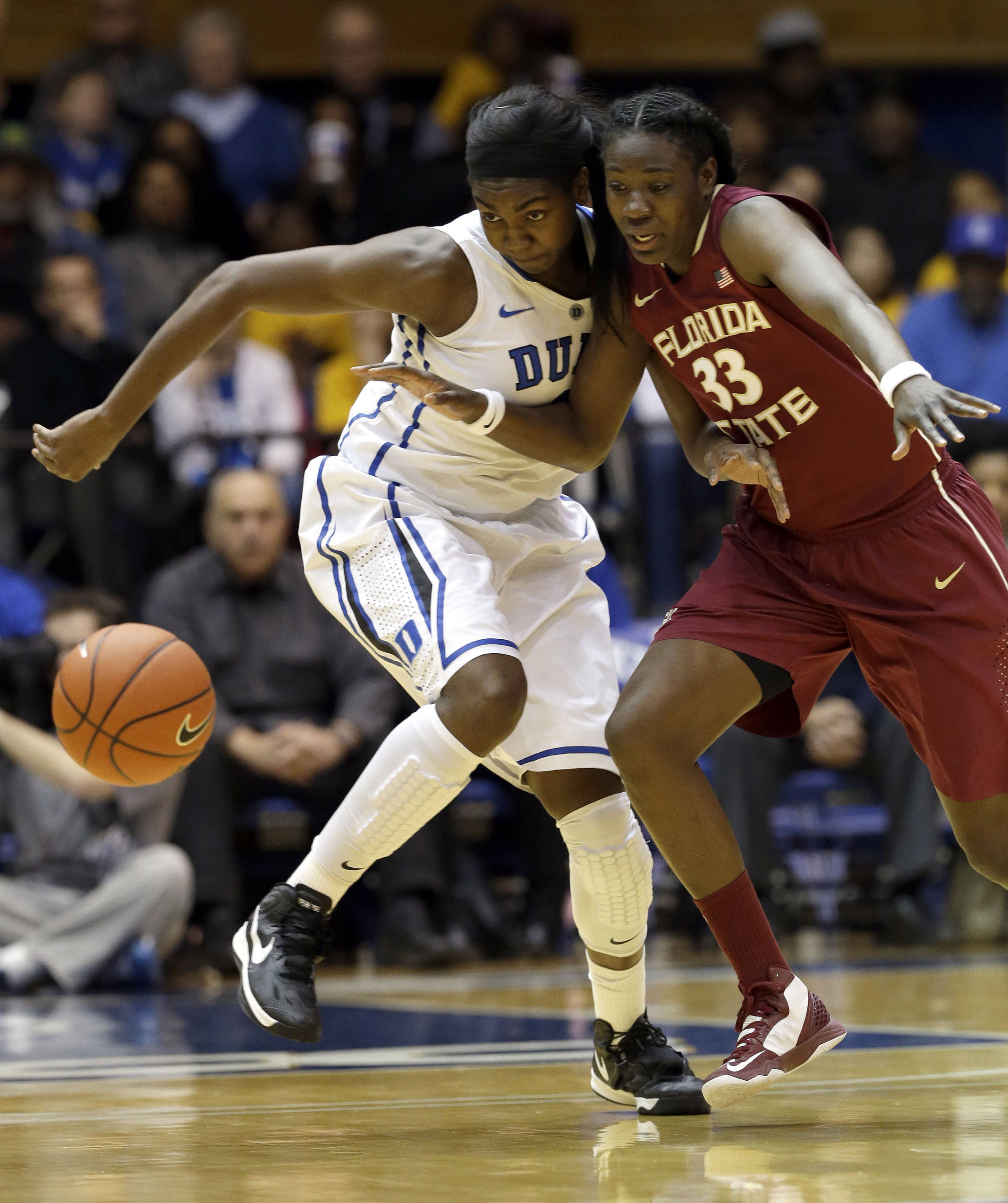 Duke's Elizabeth Williams, left, and Florida State's Natasha Howard (33) chase the loose ball during the first half. (AP Photo/Gerry Broome)