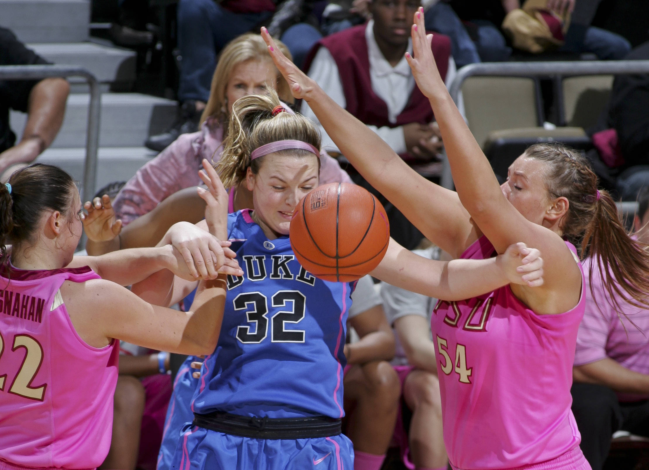 Florida State's Olivia Bresnahan (22) and Cierra Bravard (54) tie up Duke's Tricia Liston (32). (AP Photo/Phil Sears)