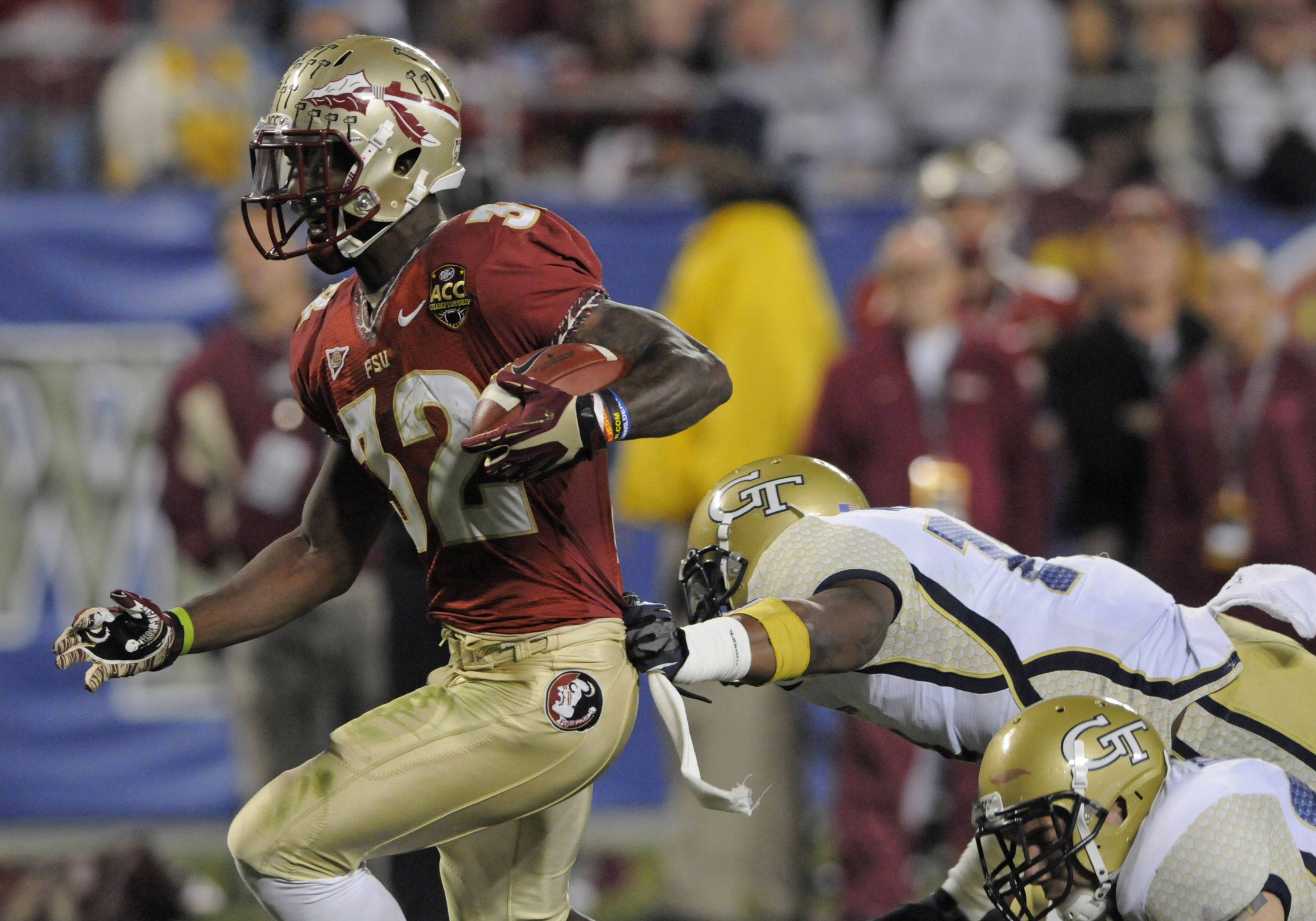 Florida State's James Wilder Jr. (32) runs into the end zone for  a touchdown past Georgia Tech's Brandon Watts (11) during the first half. (AP Photo/Mike McCarn)