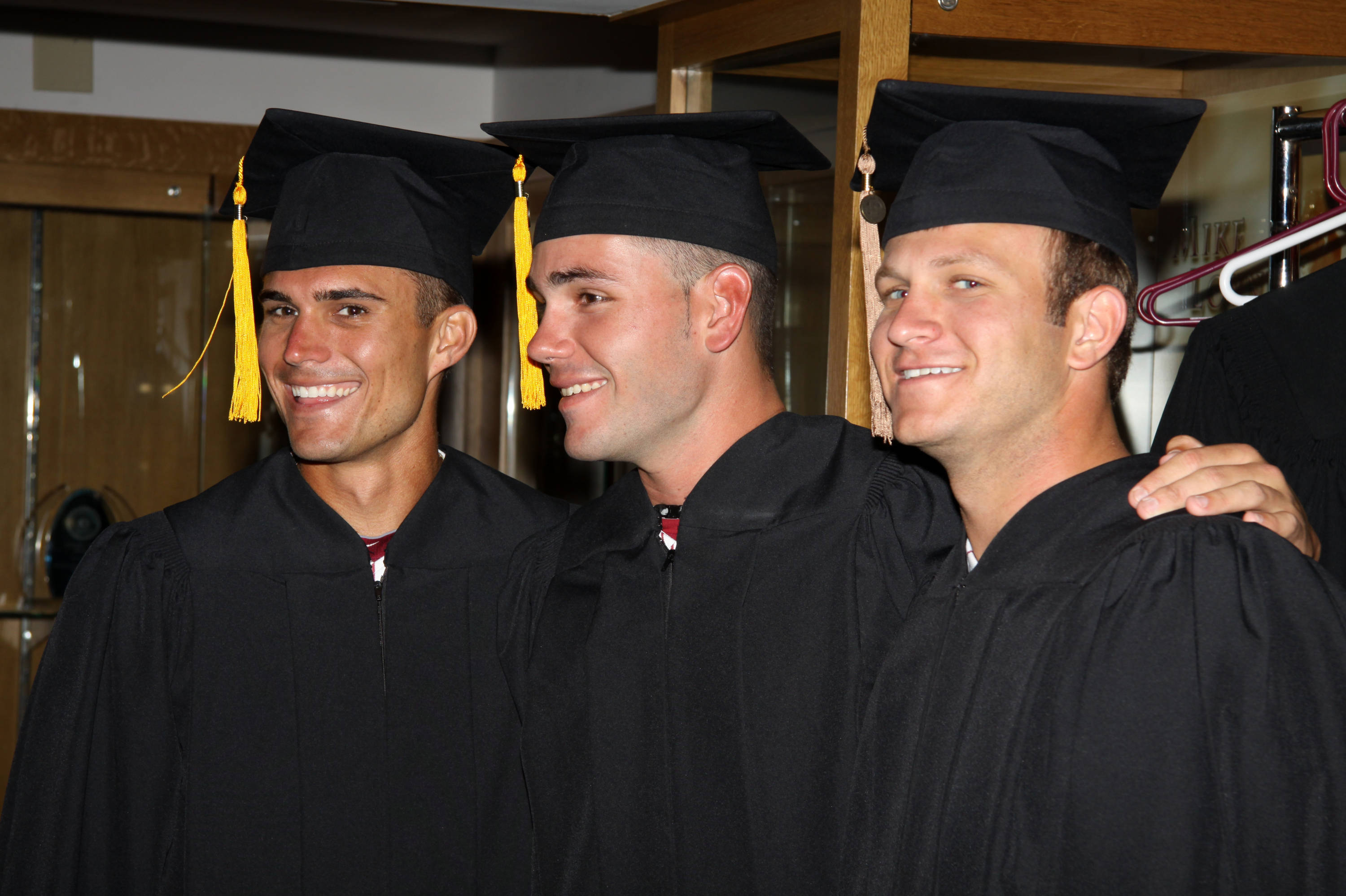 2011 Spring Graduation Ceremony held at Dick Howser Stadium to honor the graduating baseball seniors. Robby Stahl (17), Tyler Everett (28), Robby Scott (36)
