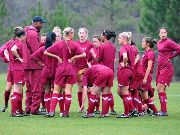 The Seminoles huddle before taking on Georgia to begin the spring season.