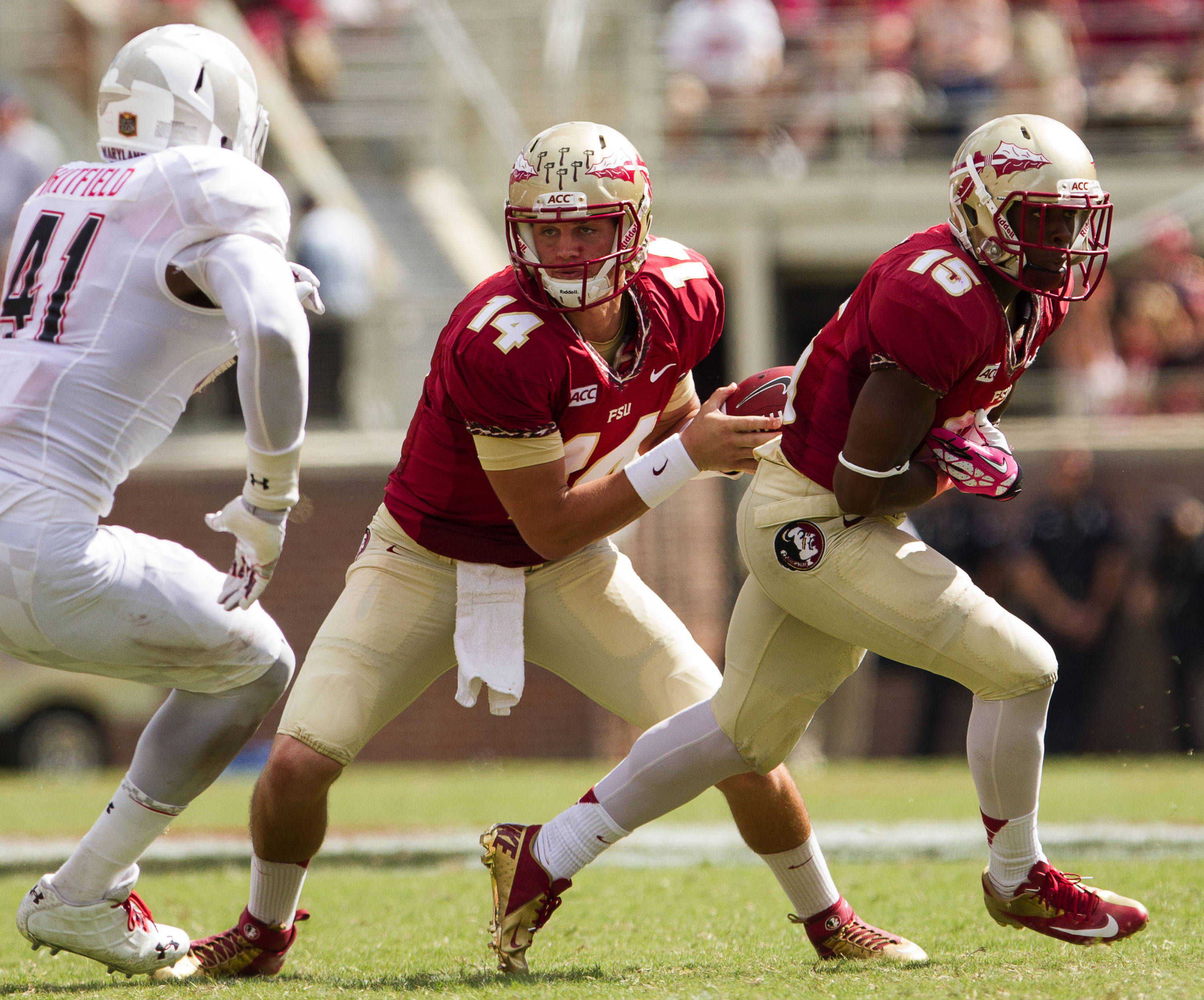 Jacob Coker (14) fakes a handoff before running for a touchdown during FSU Football's 63-0 shutout of Maryland on Saturday, October 5, 2013 in Tallahassee, Fla.
