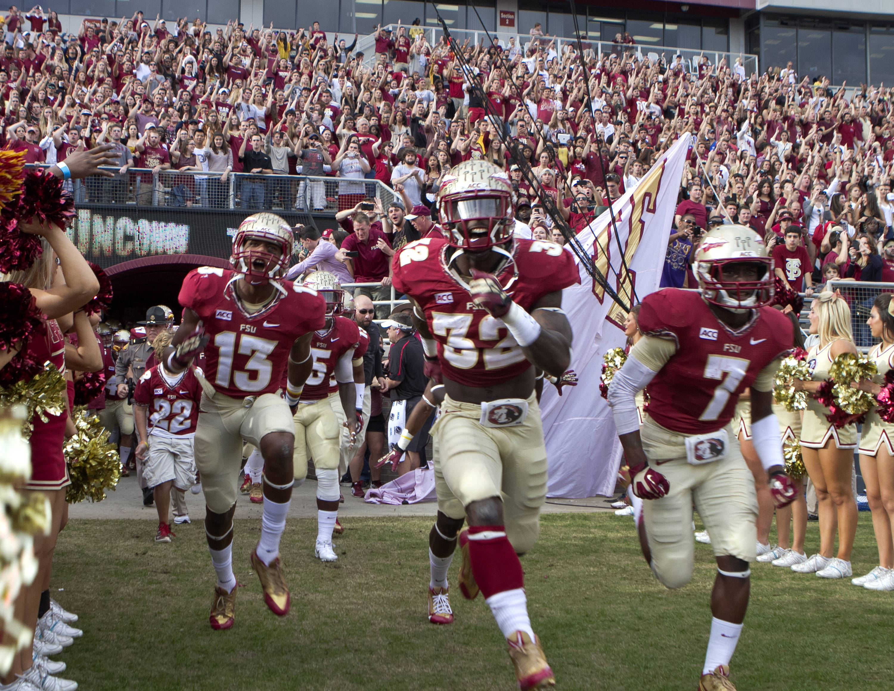 FSU heading out of the tunnel, FSU vs Syracuse, 11-16-13, (Photo by Steve Musco)