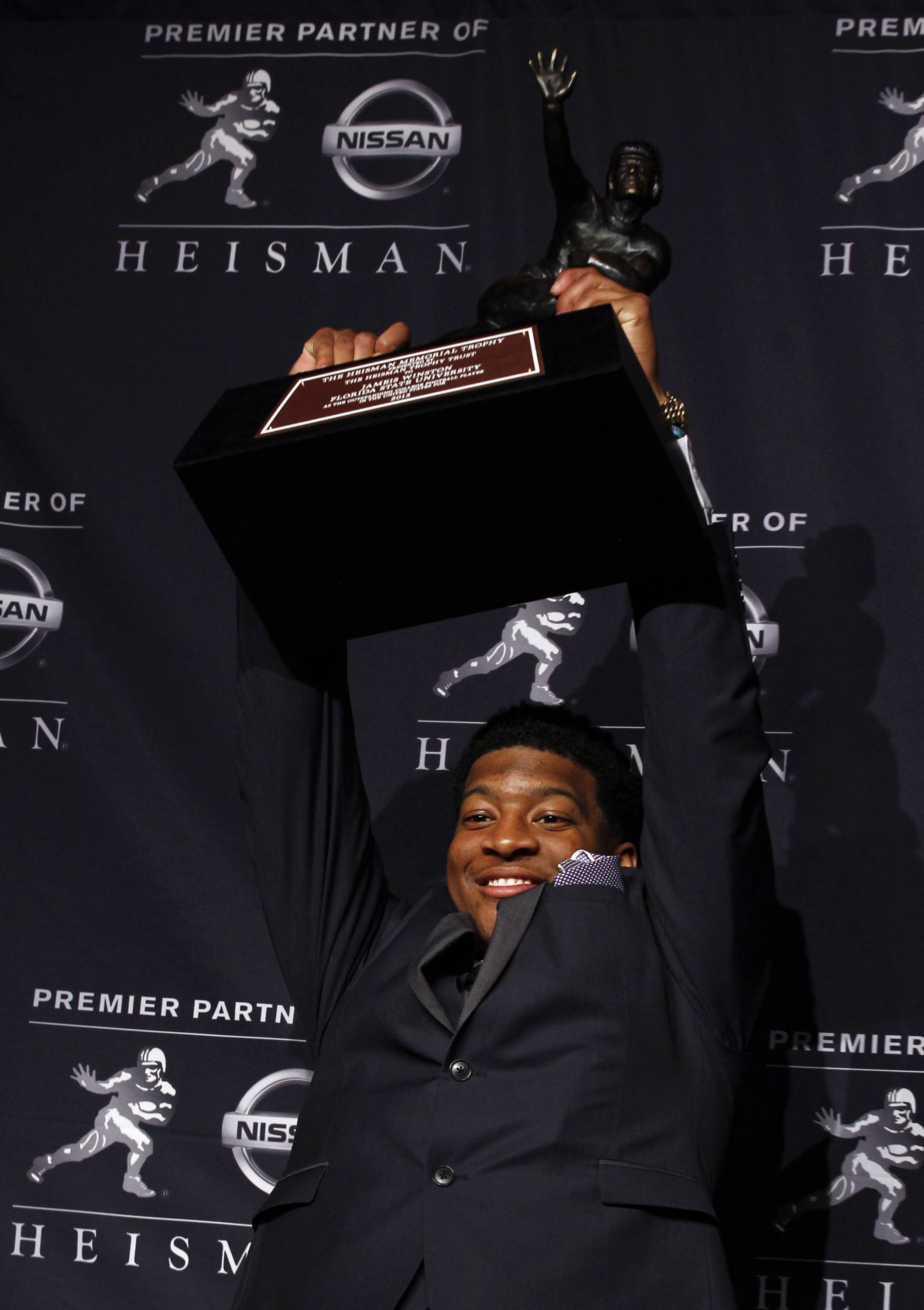 Dec 14, 2013; New York, NY, USA; Seminoles quarterback Jameis Winston poses for a photo after being awarded the 2013 Heisman Trophy at the Marriott Marquis in New York City. Adam Hunger-USA TODAY Sports