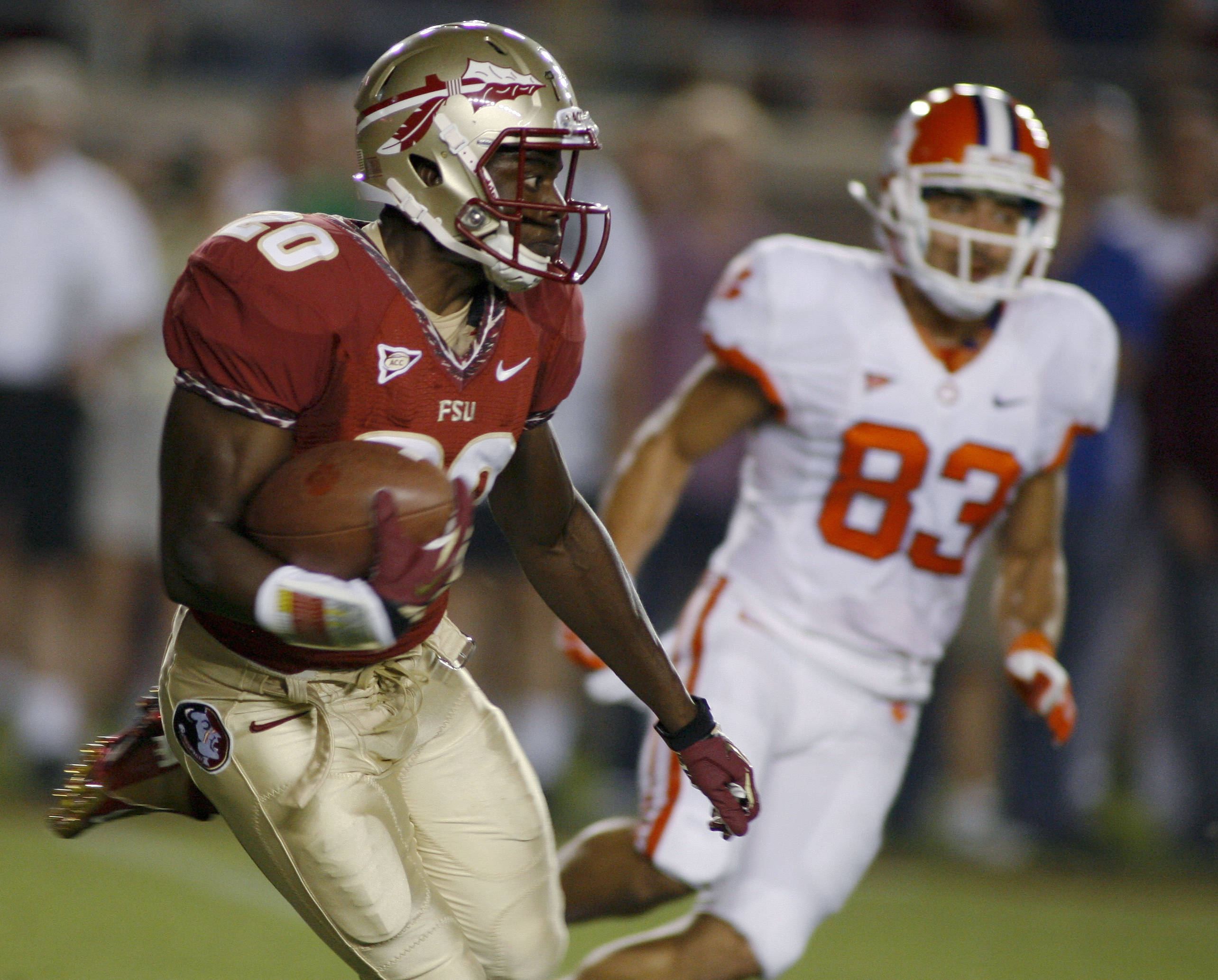 Florida State's Lamarcus Joyner (20) runs past Clemson's Daniel Rodriguez (83) on a 25-yard kickoff return. (AP Photo/Phil Sears)