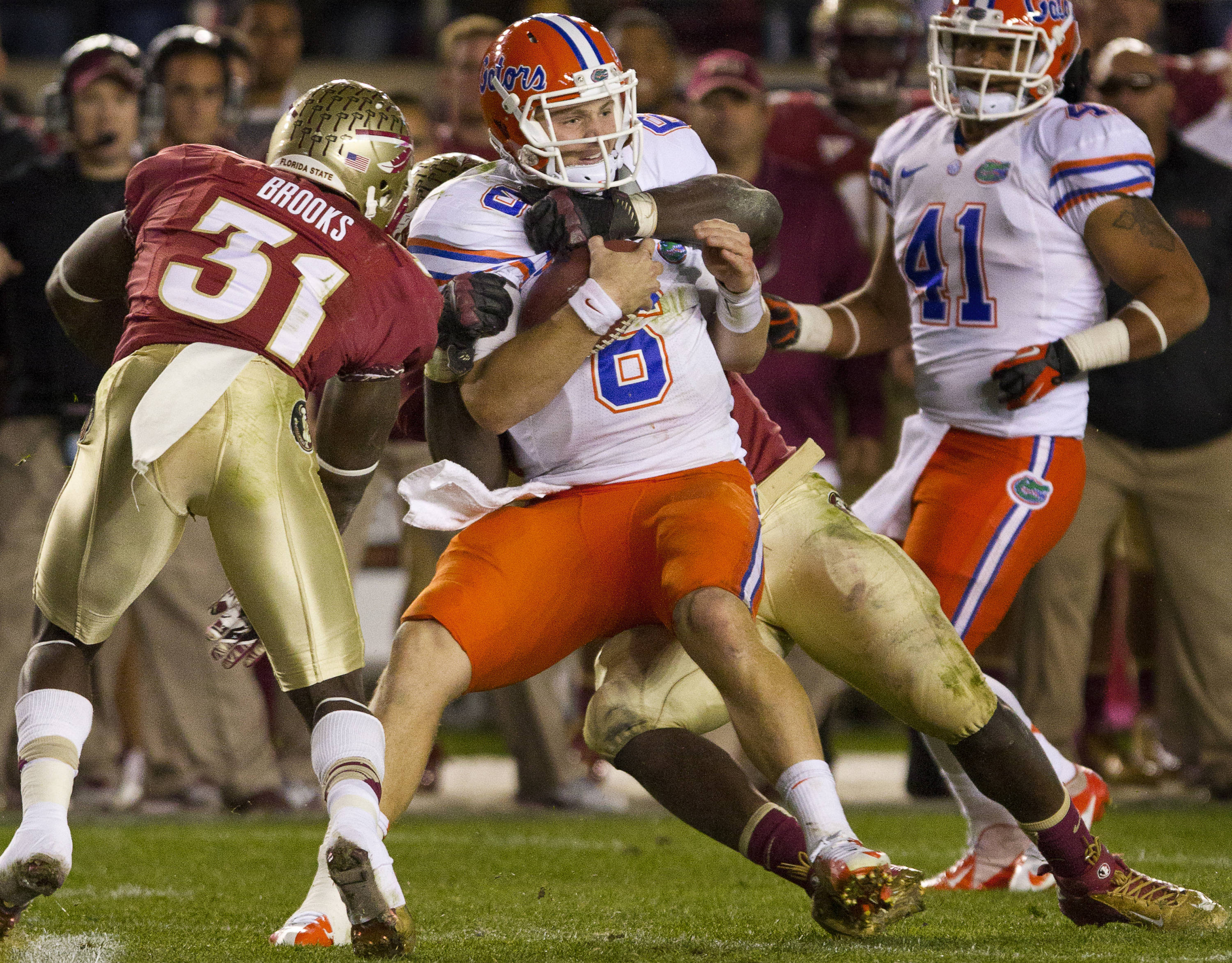 FSU defenders sack UF's quarterback during FSU Football's game against UF on Saturday, November 24, 2012 in Tallahassee, Fla.