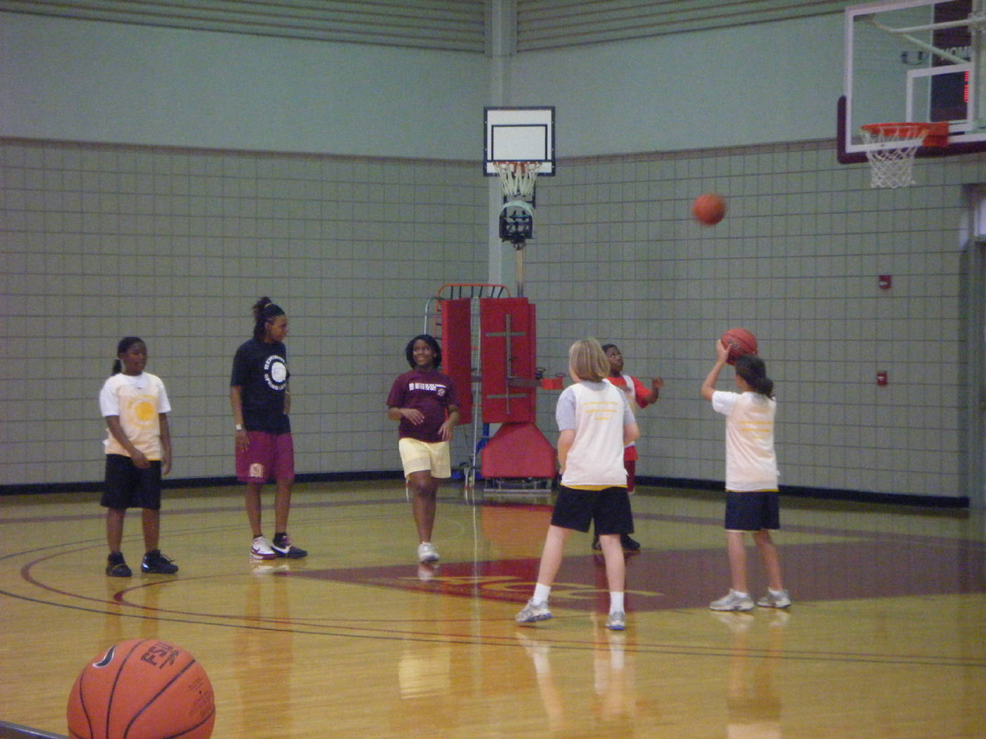 Tanae Davis-Cain helping the girls make an correct overhead pass.