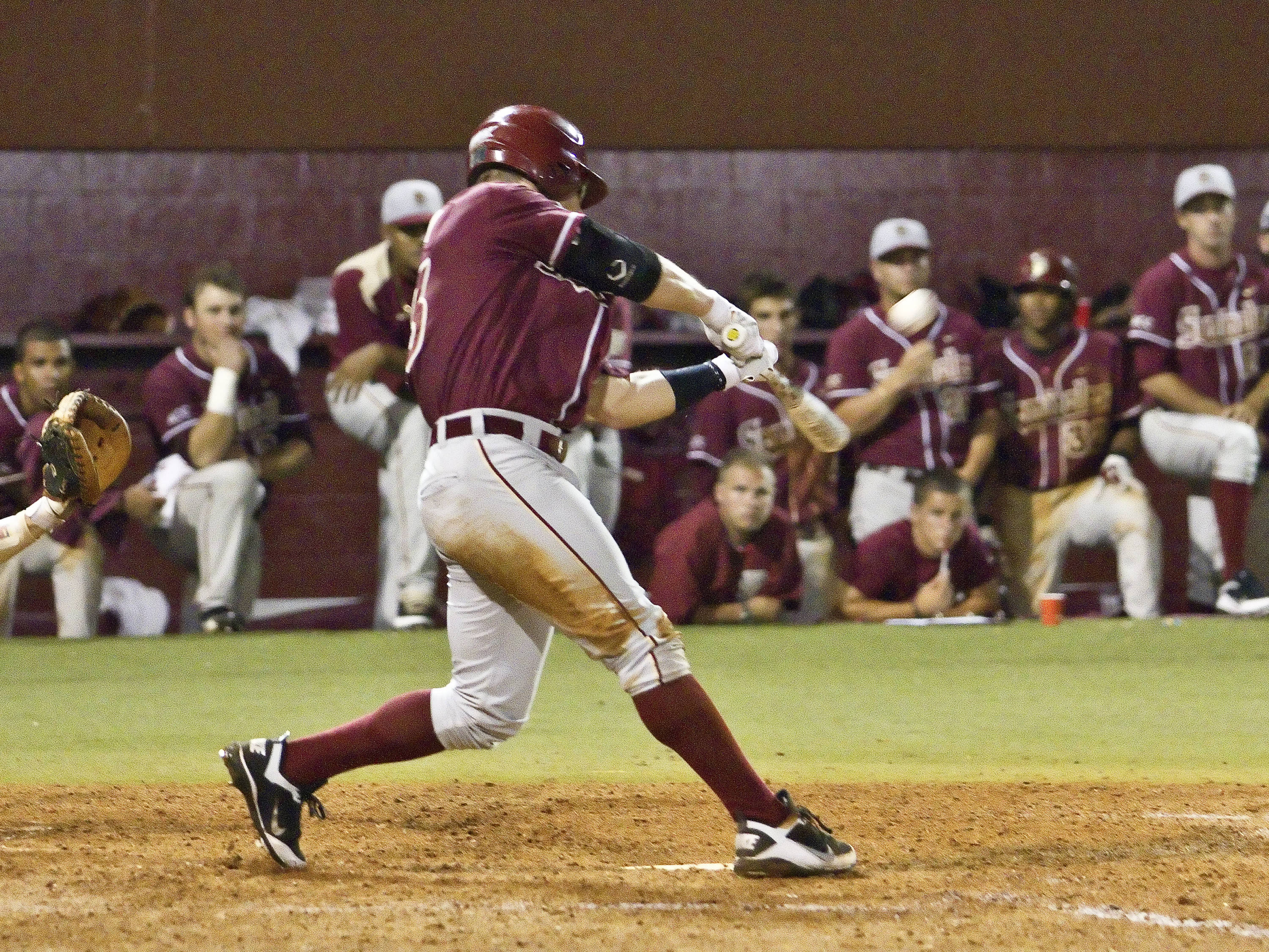 Outfielder James Ramsey (23) launching his rbi double in the 8th inning