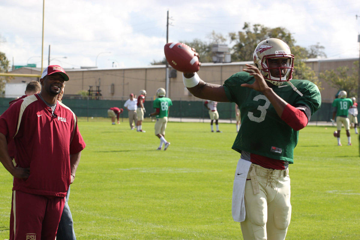 Quarterbacks Coach Dameyune Craig and QB EJ Manuel
